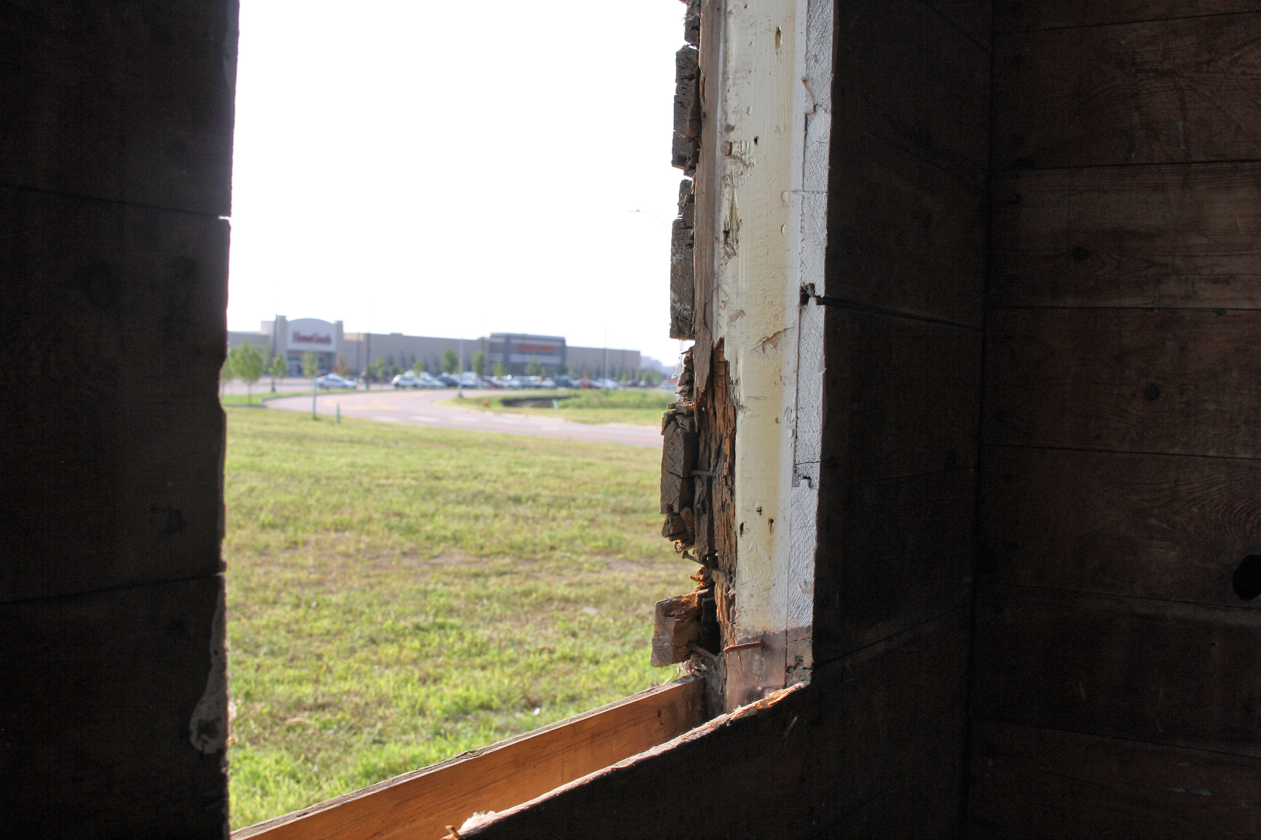 The new development can be seen from the barn's east window.
