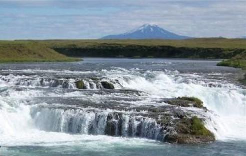 Ægisíðufoss and Mt. Hekla in the background