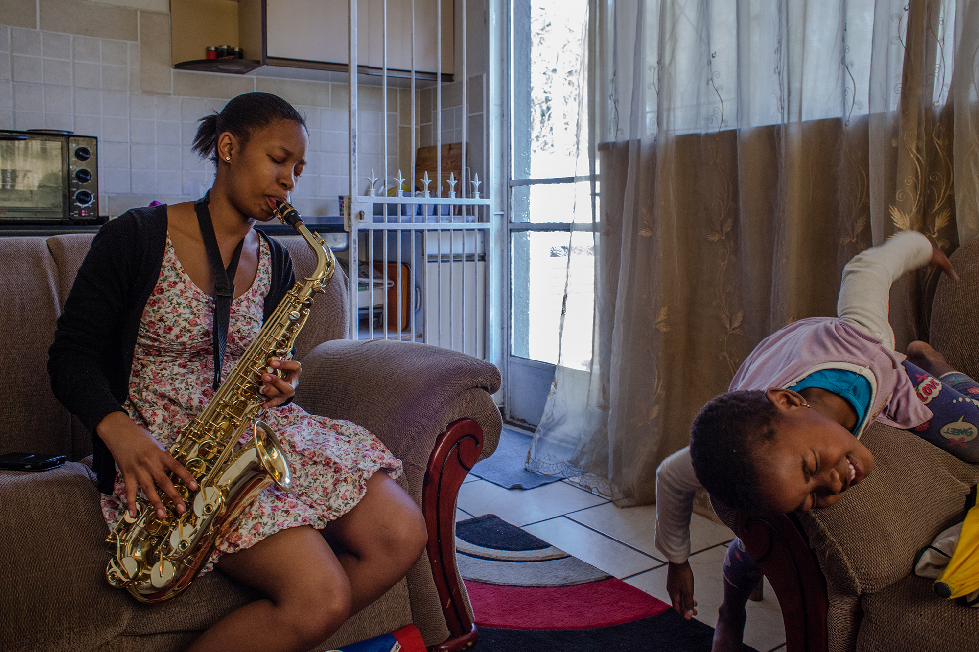 Nonkuliseko playing a saxophone at her house in Johannesburg. 2014.jpg