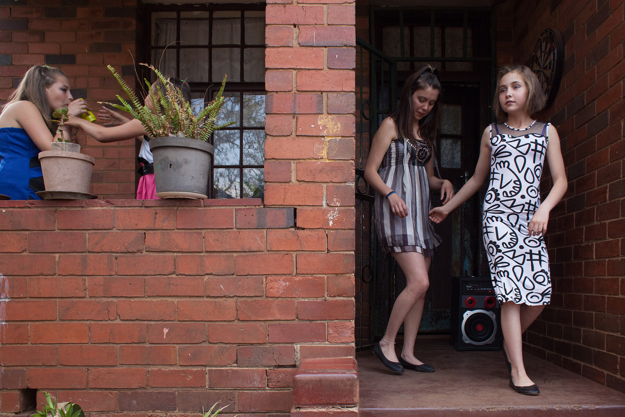 Young girls on their way to sing on the street to stop crime affecting children in Fietas, Johannesburg. 2014 .jpg