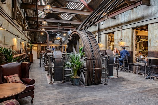 HOLMES MILL FEATURES OVER 40 BEERS AND SEVERAL ROOMS TO RELAX