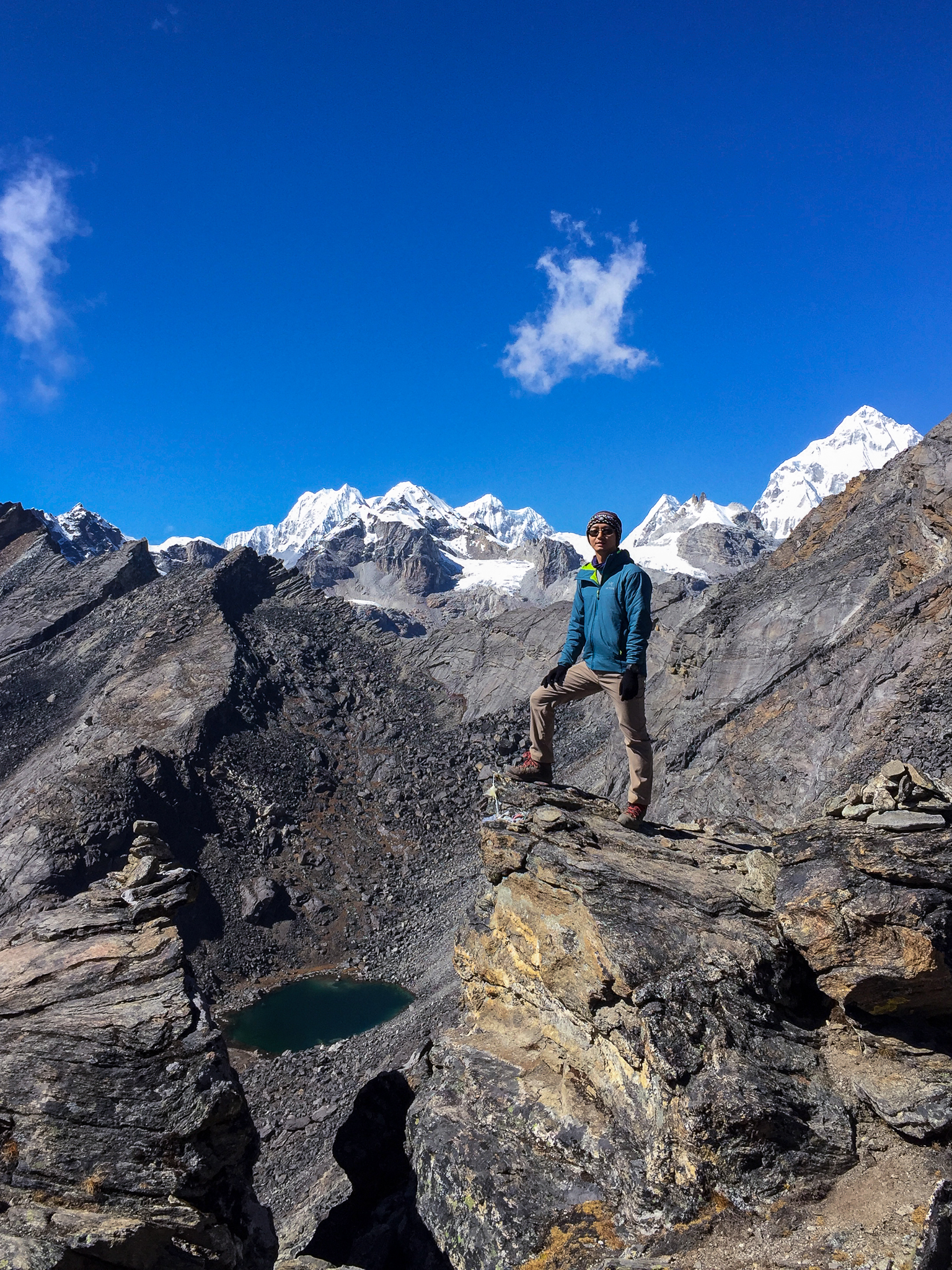 Me at the back view of the Gokyo Ri, where the clouds have not covered everything yet