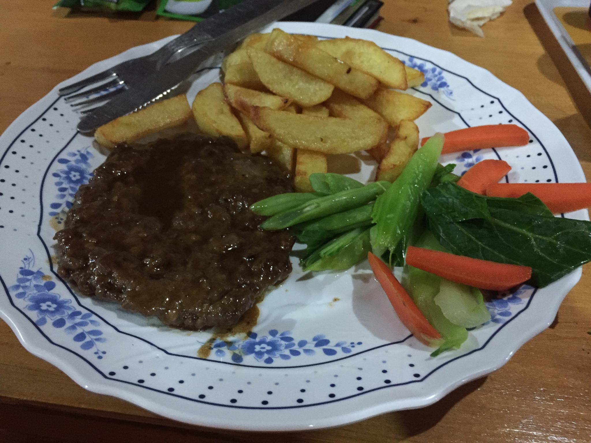 Yak steak, famous Nepali potato fries and veggies