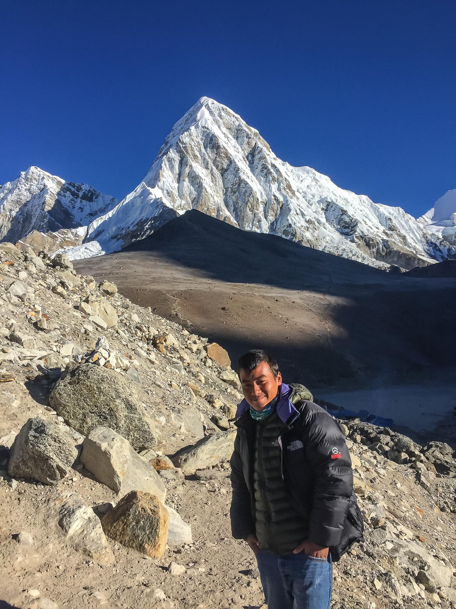 From bottom to top: Sherpa Pemba, edge of Gorakshep (5,164m), darkened hill top of Kalapathar (5,645m), Pumo Ri (7,165m)