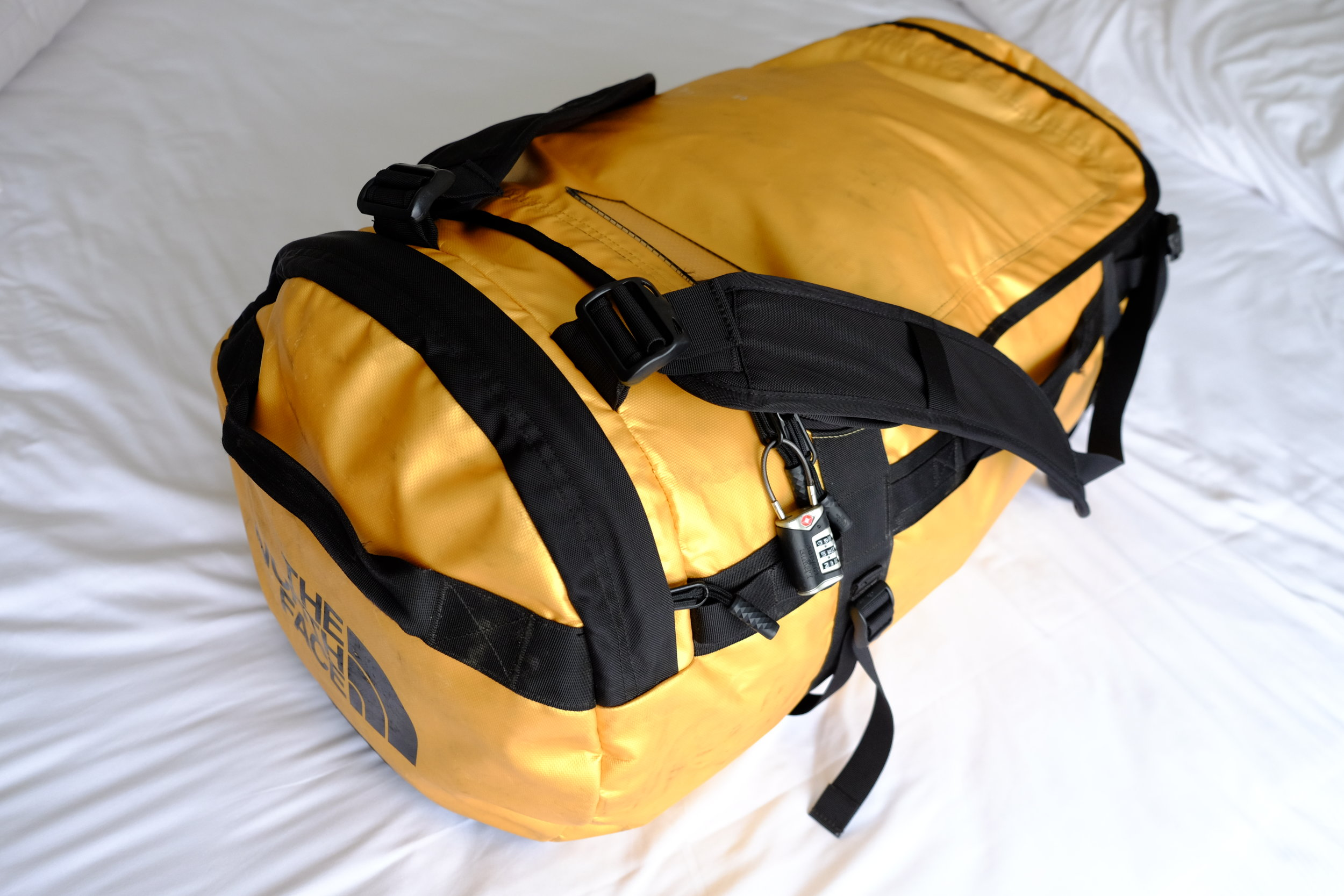 North Face Base Camp Duffel  w/  Lewis N. Clark combination cable lock . This is how it looks with EVERYTHING (incl daypack & boots)stuffed into the duffel