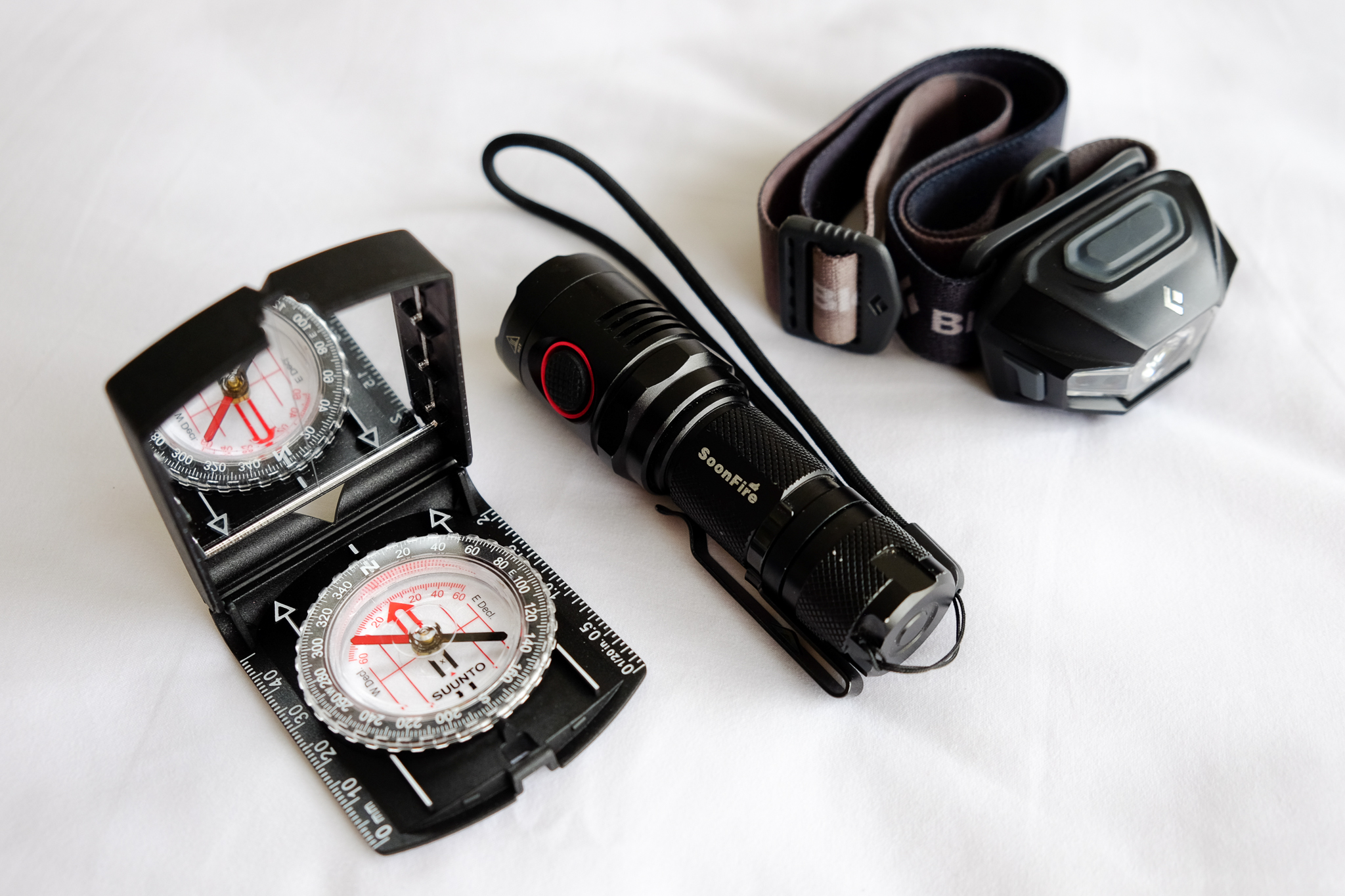 Suunto MCB Compass ,  SoonFire NS-17 flashlight ,  Black Diamond Revolt headlight