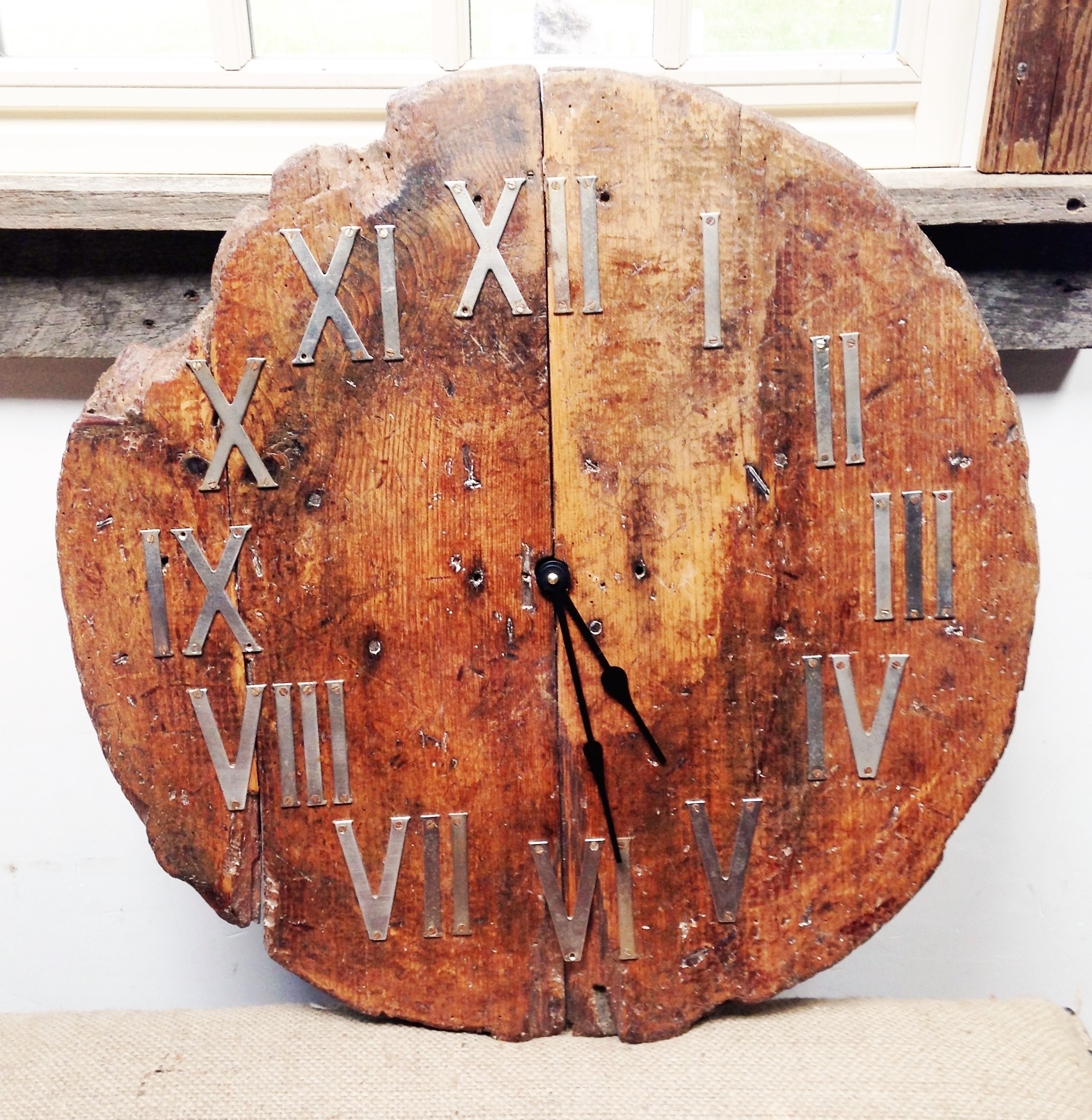 A fine example of re-purposing: a weathered barrel top becomes a one-of-a-kind clock.