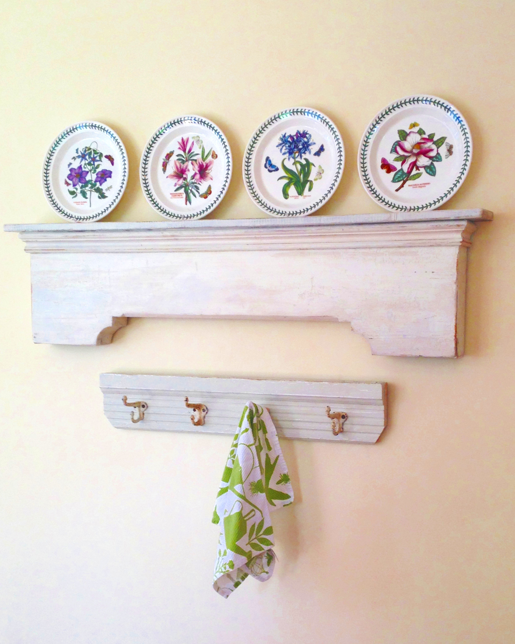 Simplicity itself....sections of an old mantle and a chair railing re-purposed as shelf and hooks in a clients kitchen.