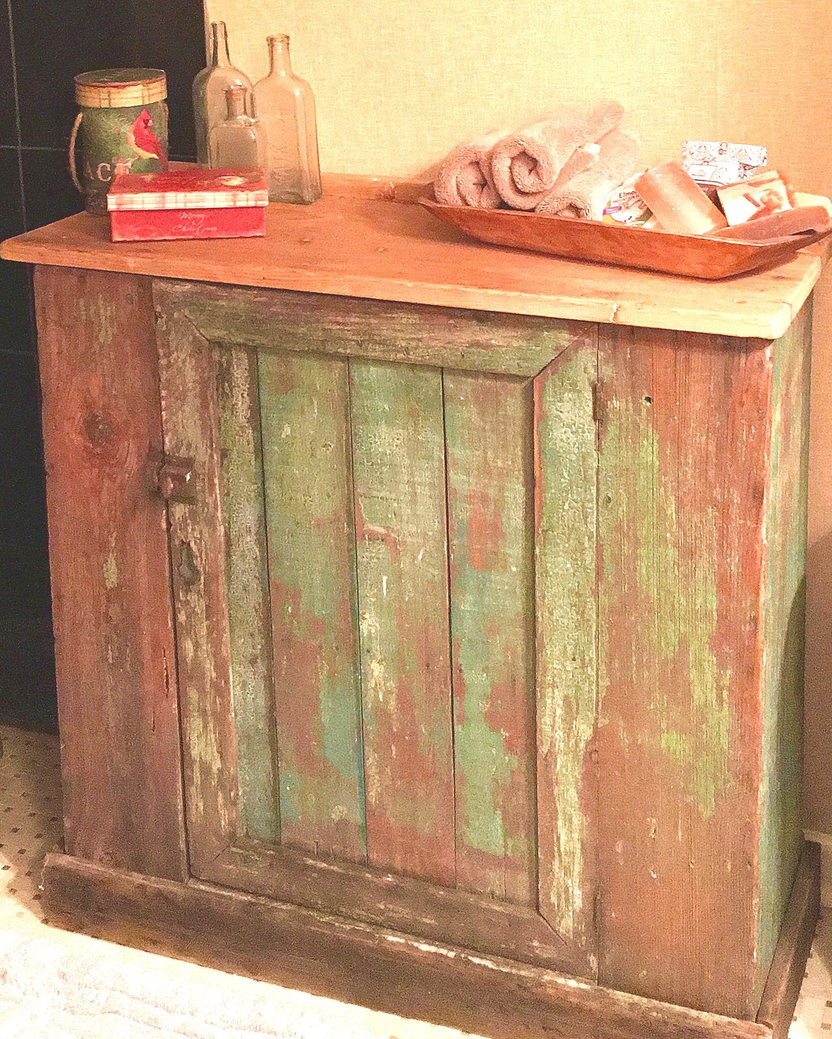The old worn paint on this little cupboard made it the perfect piece to warm up a clients newly renovated bathroom.