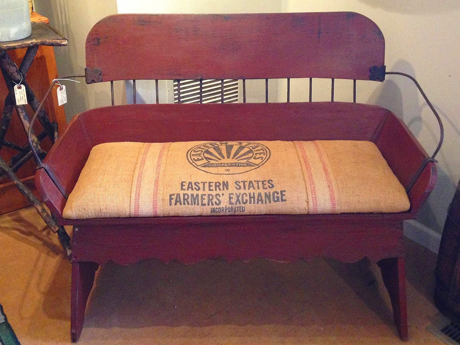 An old burlap feed sack makes an excellent cushion for this restored buggy bench.