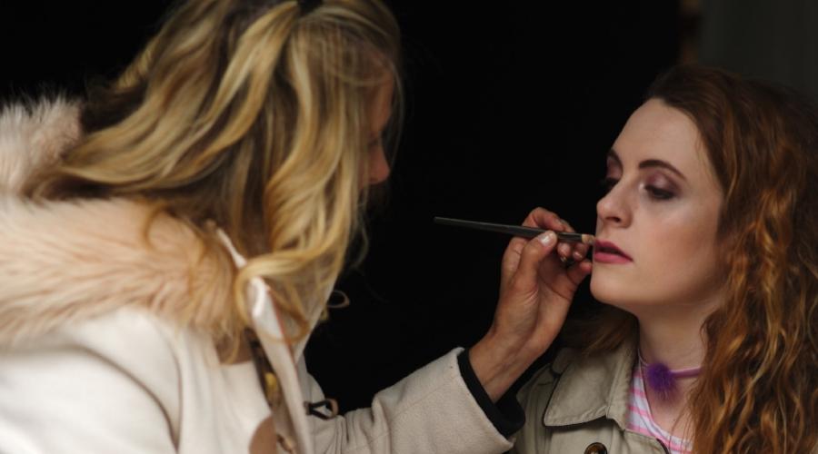 Applying makeup to model