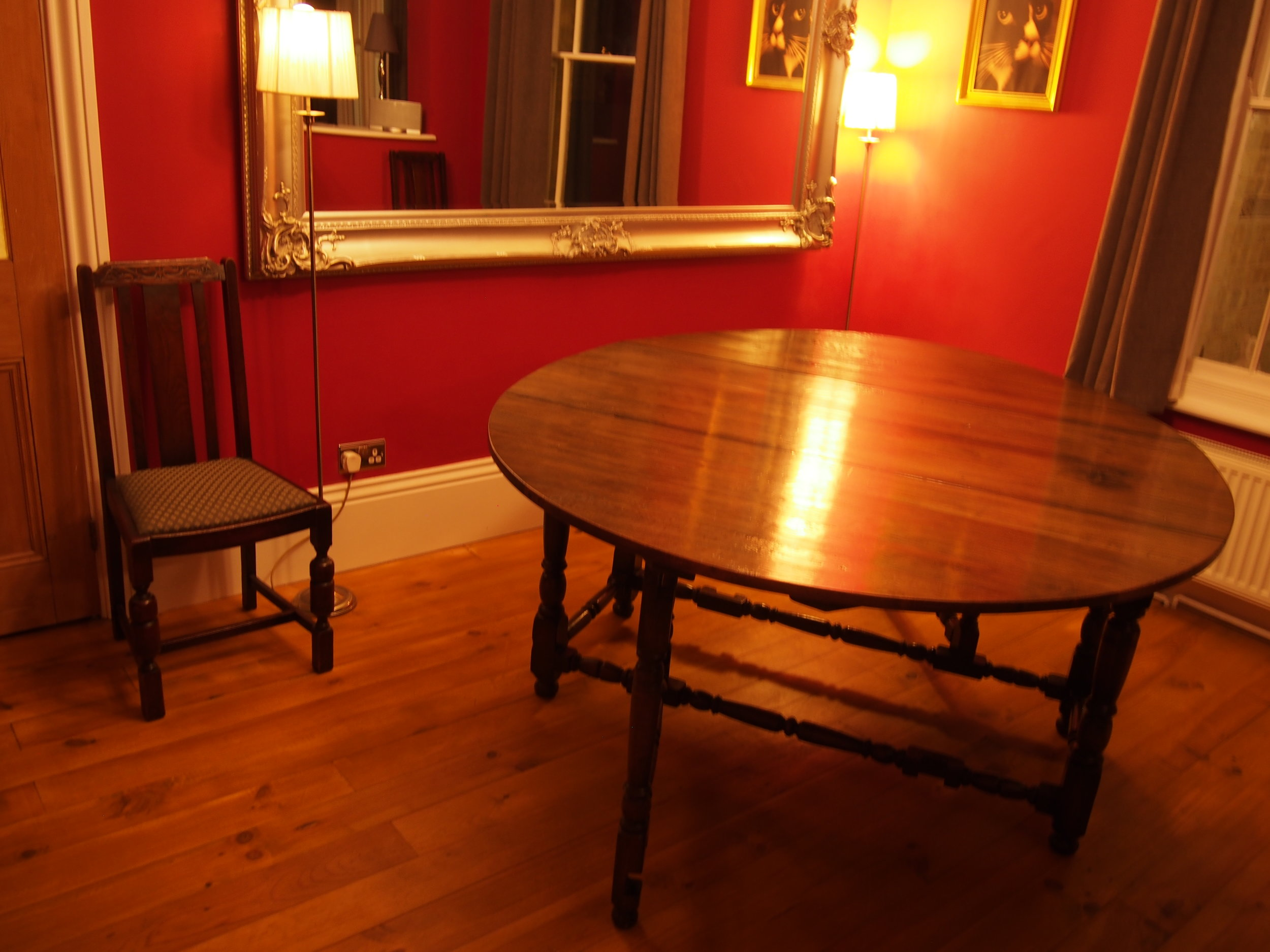 "This ""much-loved"" Oak Drop Leaf Dining Table was commissioned for the overall size of the table to be altered and minimised. This was to enhance the functionality of the piece giving a smaller proportion and plenty of space to move around. The edges were then re-polished to match the original colour.  The table was firstly measured and cut to the given size. The newly exposed edge were then sanded and shaped smoothly to the original shape of the cut off edges. A matching finish was then applied to the edges to blend in with the existing appearance of the table as if it had not been altered."