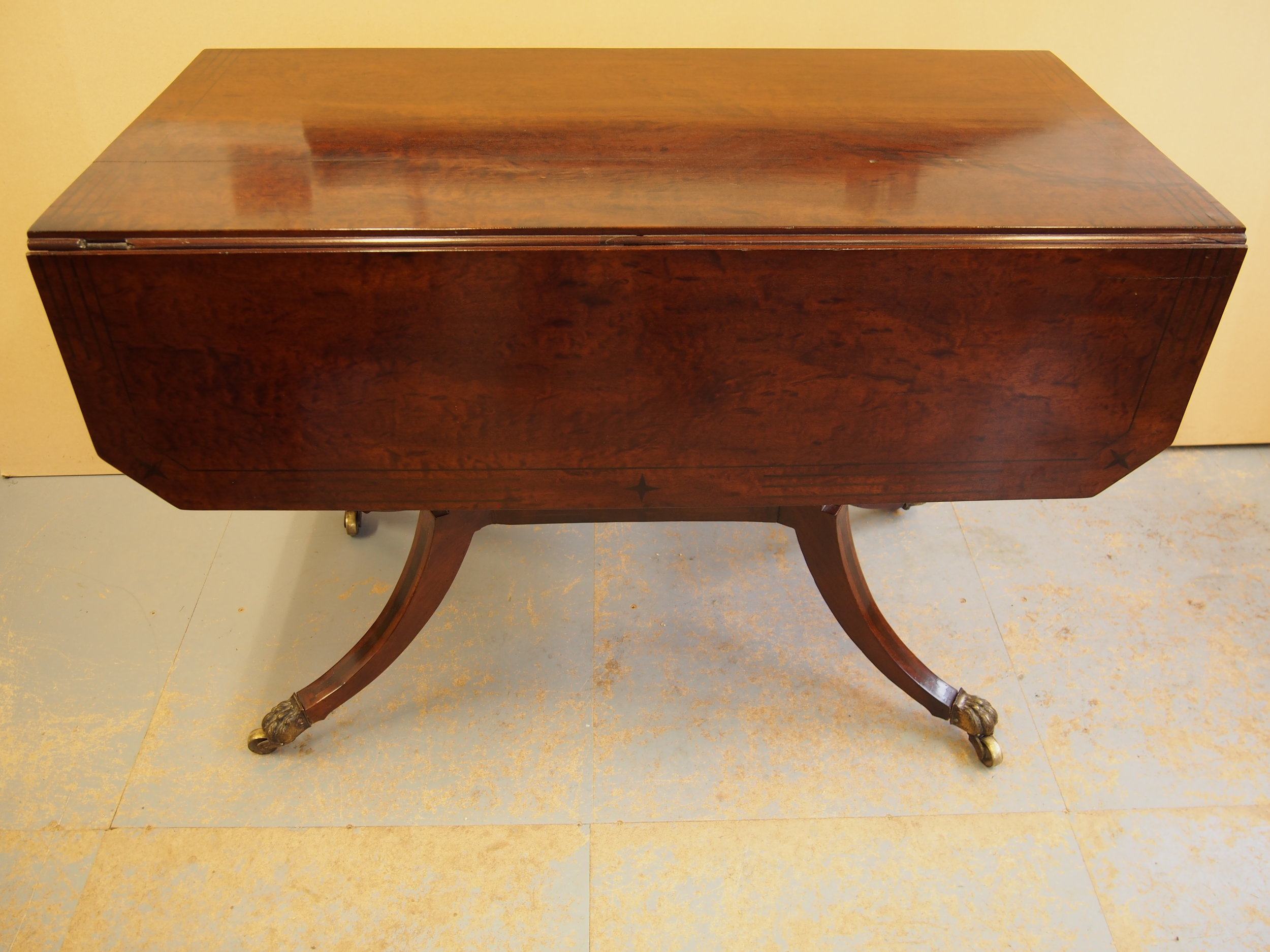 The restoration and repair of this Card Table was to repair a loose and broken Lions claw castor.
