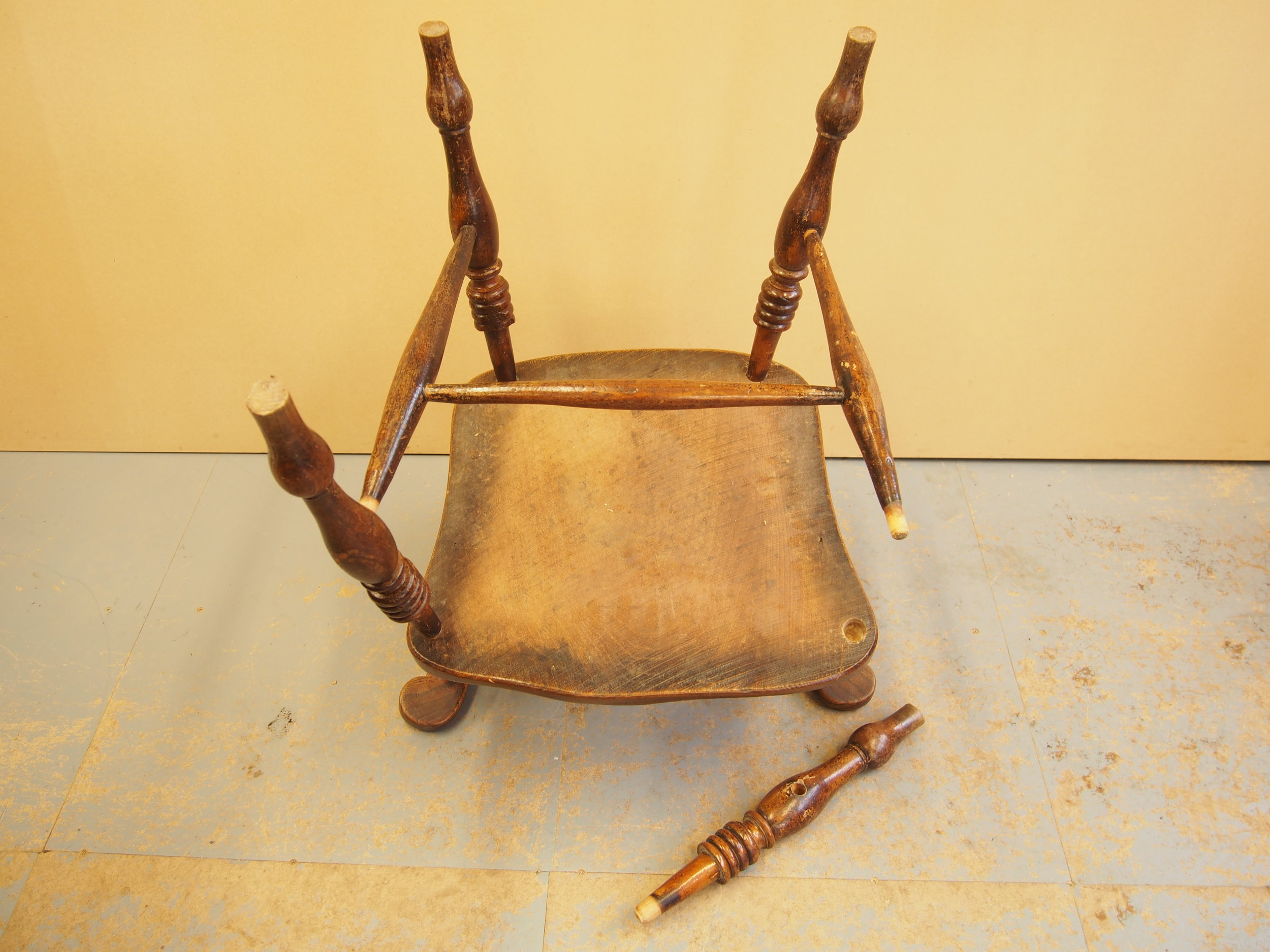 The Captains Chair was presented with loose joints on the entire under frame. One leg was detached and the entire surface of the chair was coated with a thick and dark finish.
