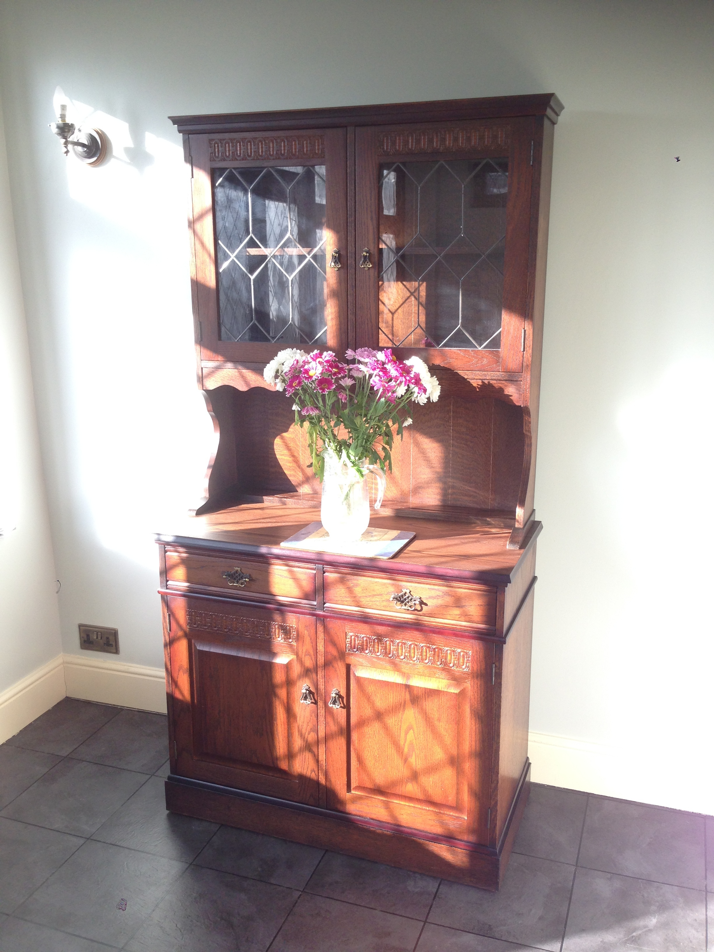 The Oak Traditional Dresser was presented with a heavily marked and stained top surface, which needed to be stripped back and re polished to match the original colour. There were several knocks and bruised edges on the corners and bottom of the piece that needed attention and re polishing.