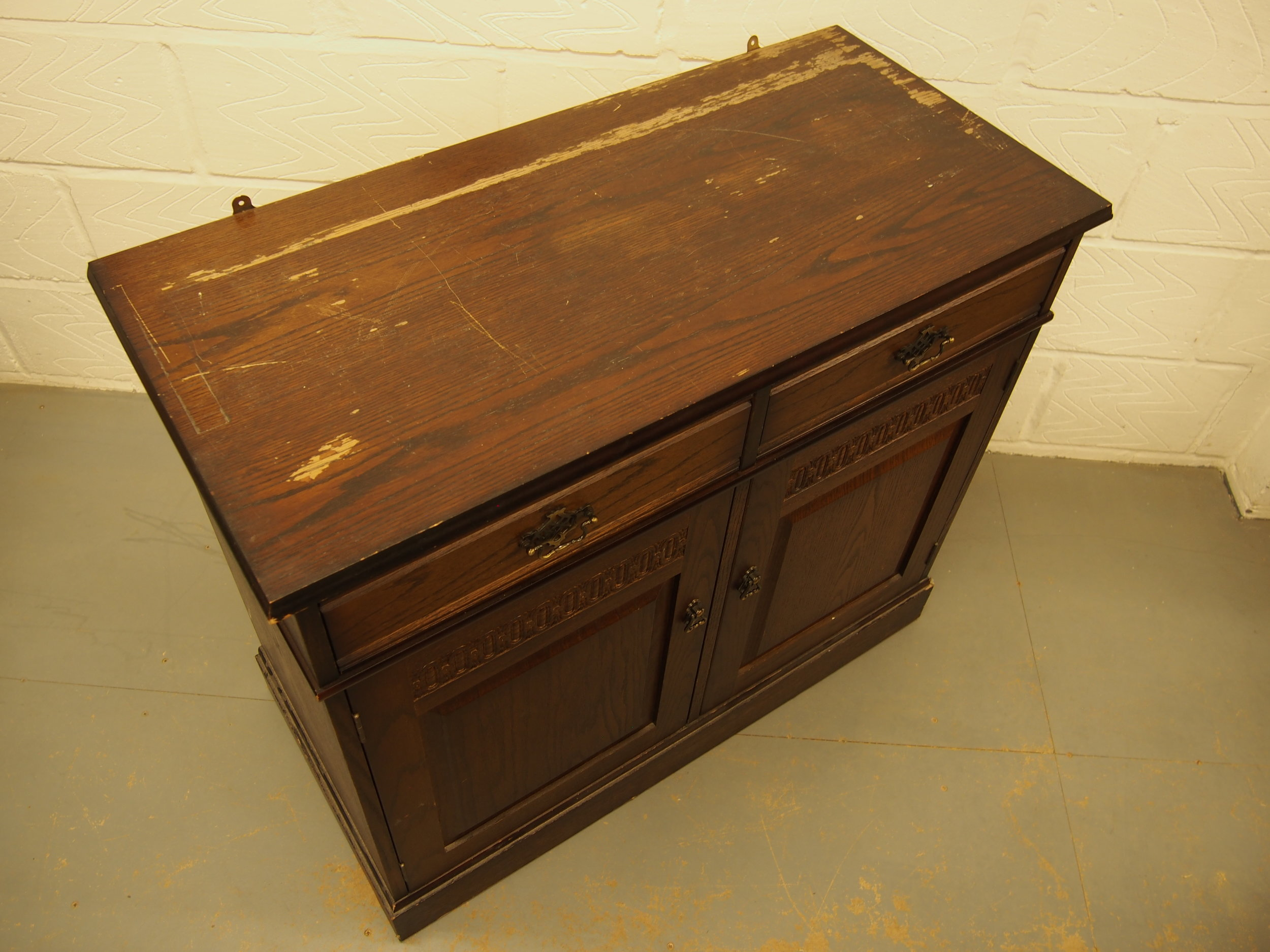 Original condition of the Oak Traditional Dresser. Many marks, scratches and stains were evident. The entire surface was striped and then re polished to match the existing colour.