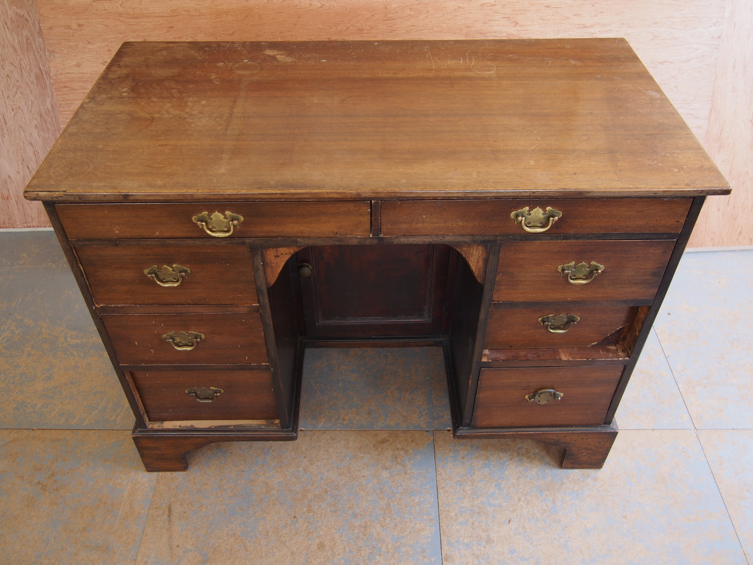 The Antique Walnut Desk was presented with several water marks, ink stains and scratches that needed to be removed. It was evident that several areas had broken and missing parts needed to be re made.