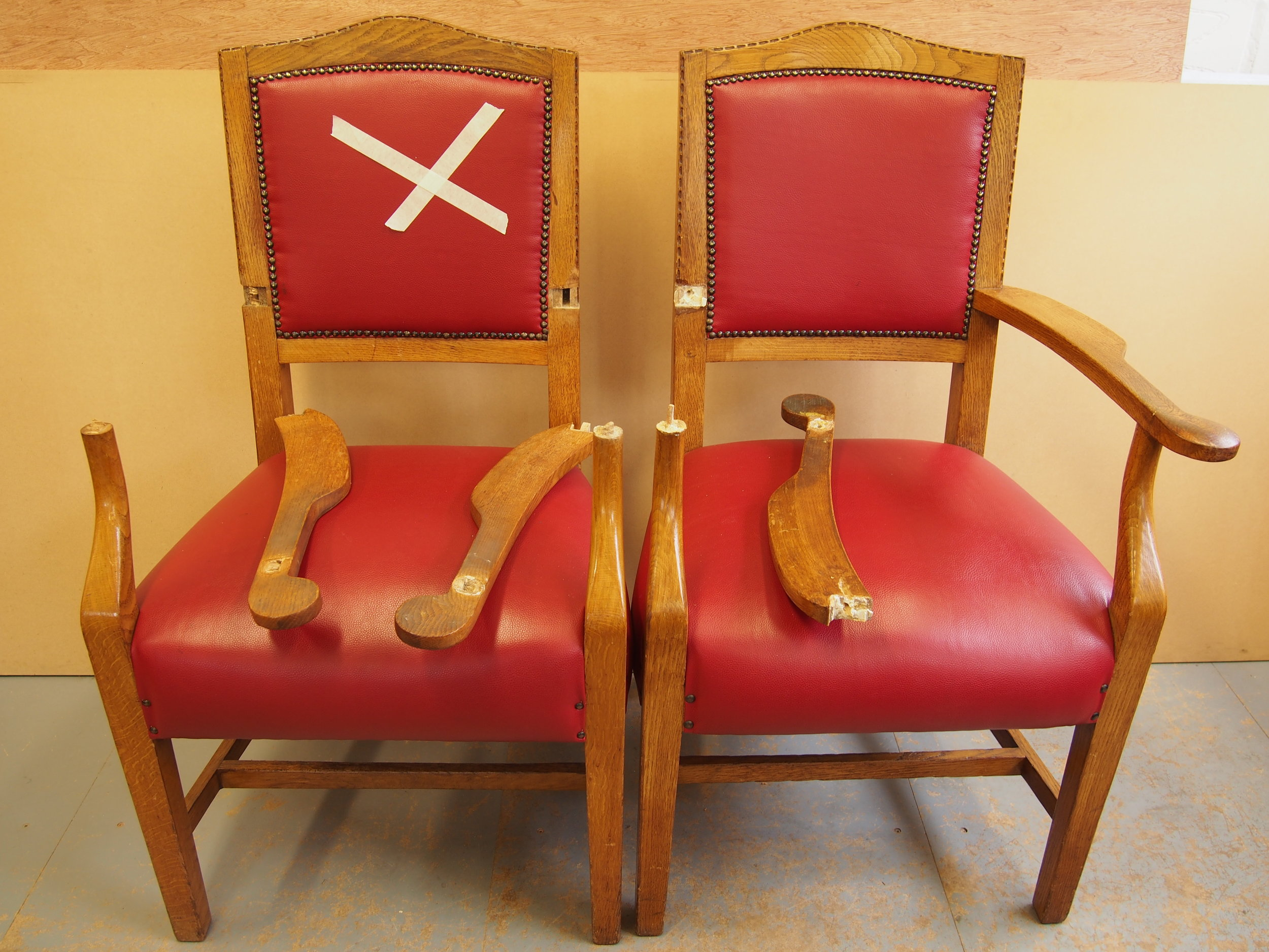 Before Restoration of Oak Conference Arm Chairs   The original condition of two Oak Conference Arm Chairs from a set of eight, had broken arm rests and joints.