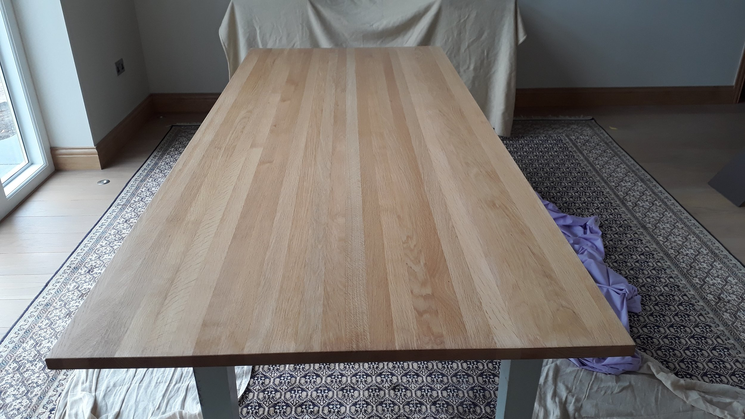Before Restoration of Modern Oak Dining Table   The Oak Table required removing the effect surface finish and scratches. A clear finish was then to be applied.