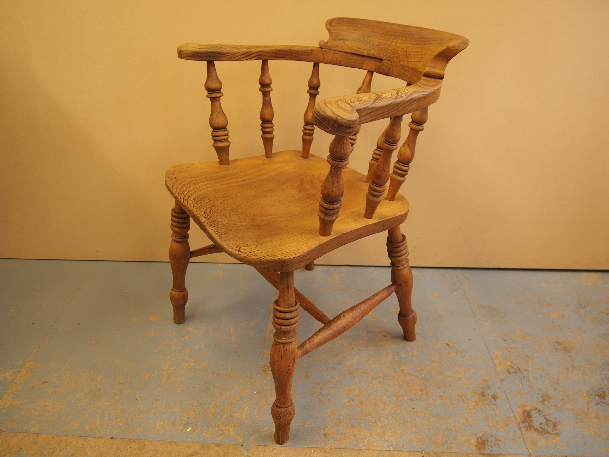 After Restoration of Captain's Arm Chair   This sentimental Captain's Arm Chair was to be stripped of its original dark finish and to have a light brown finish applied.