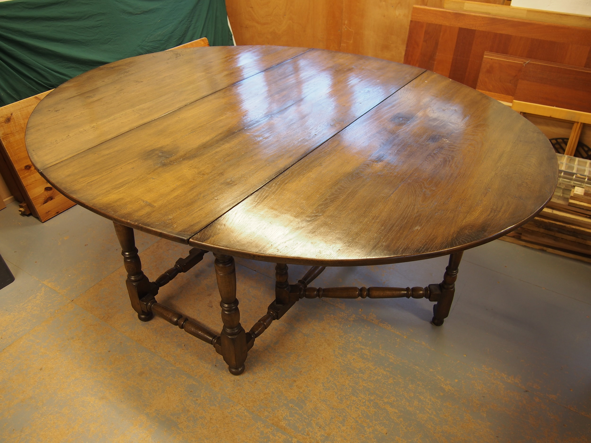 Before Restoration of Oak Drop Leaf Dining Table   Taking up a lot of room in the clients dining room. The request was to cut the diameter off the table to a smaller size.