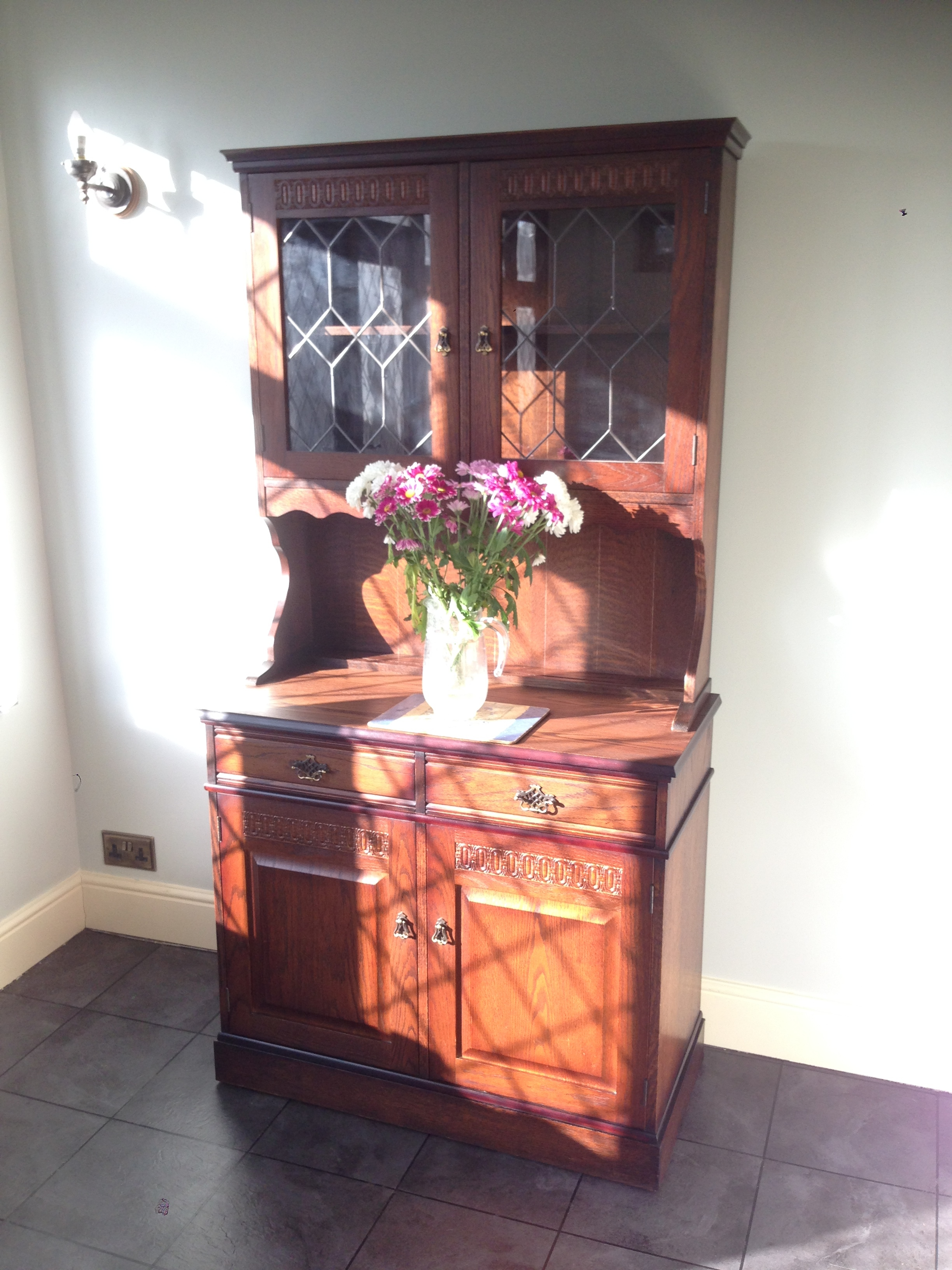 After Restoration of Oak Traditional Dresser   Presented with a heavily marked and stained top surface, the piece required to be stripped back and re polished.