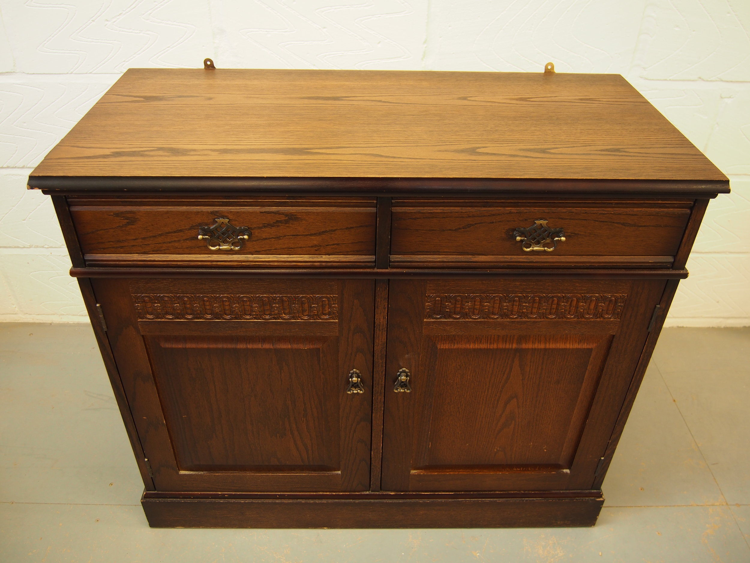 During Restoration of Oak Traditional Dresser   The scratches were removed from the top surface and the colour finish was applied.