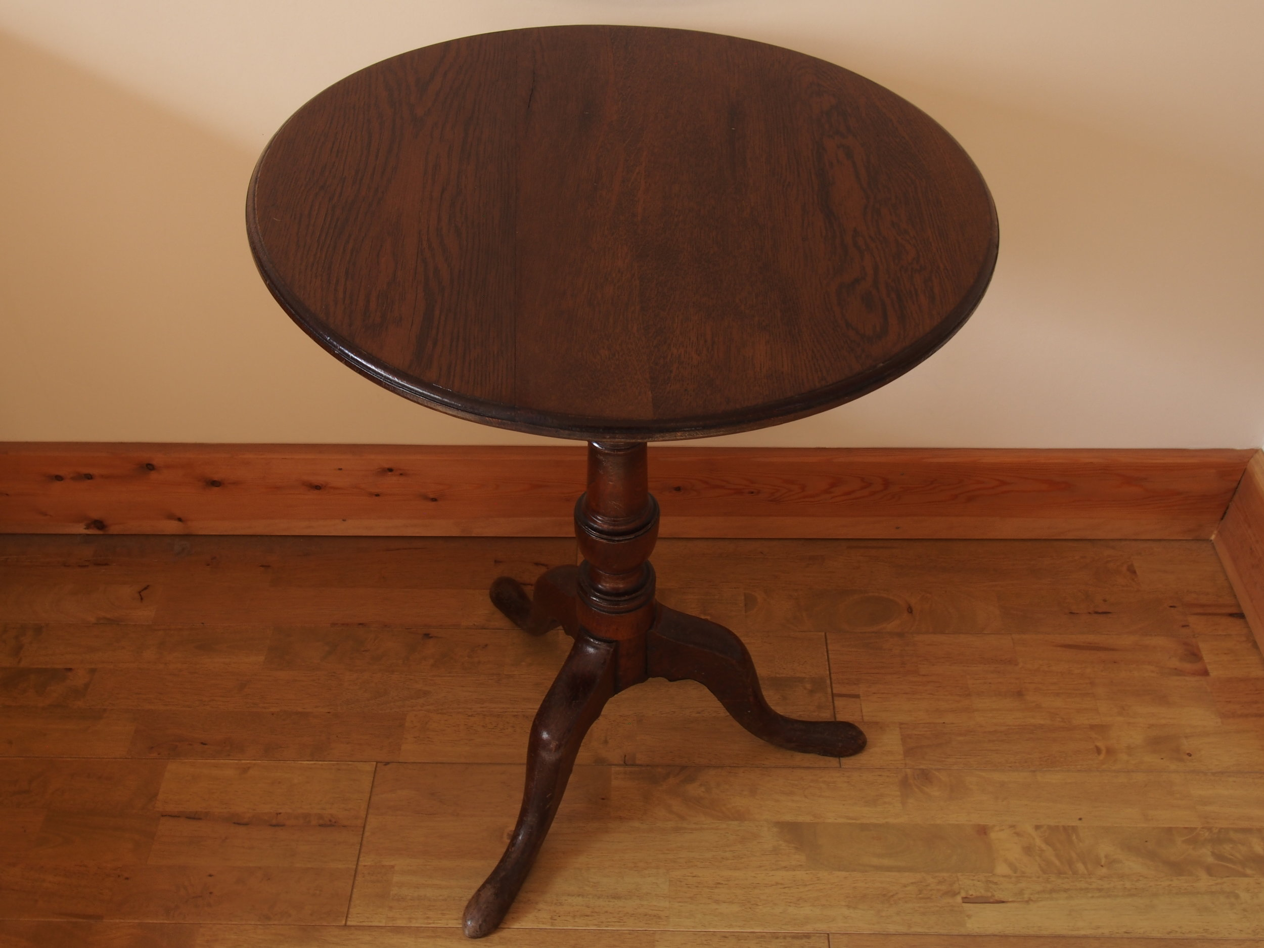 After Restoration of Oak Pedestal Pub Table   Fully restored the split has been removed and the surface has been re-polished with removing all existing scratches.