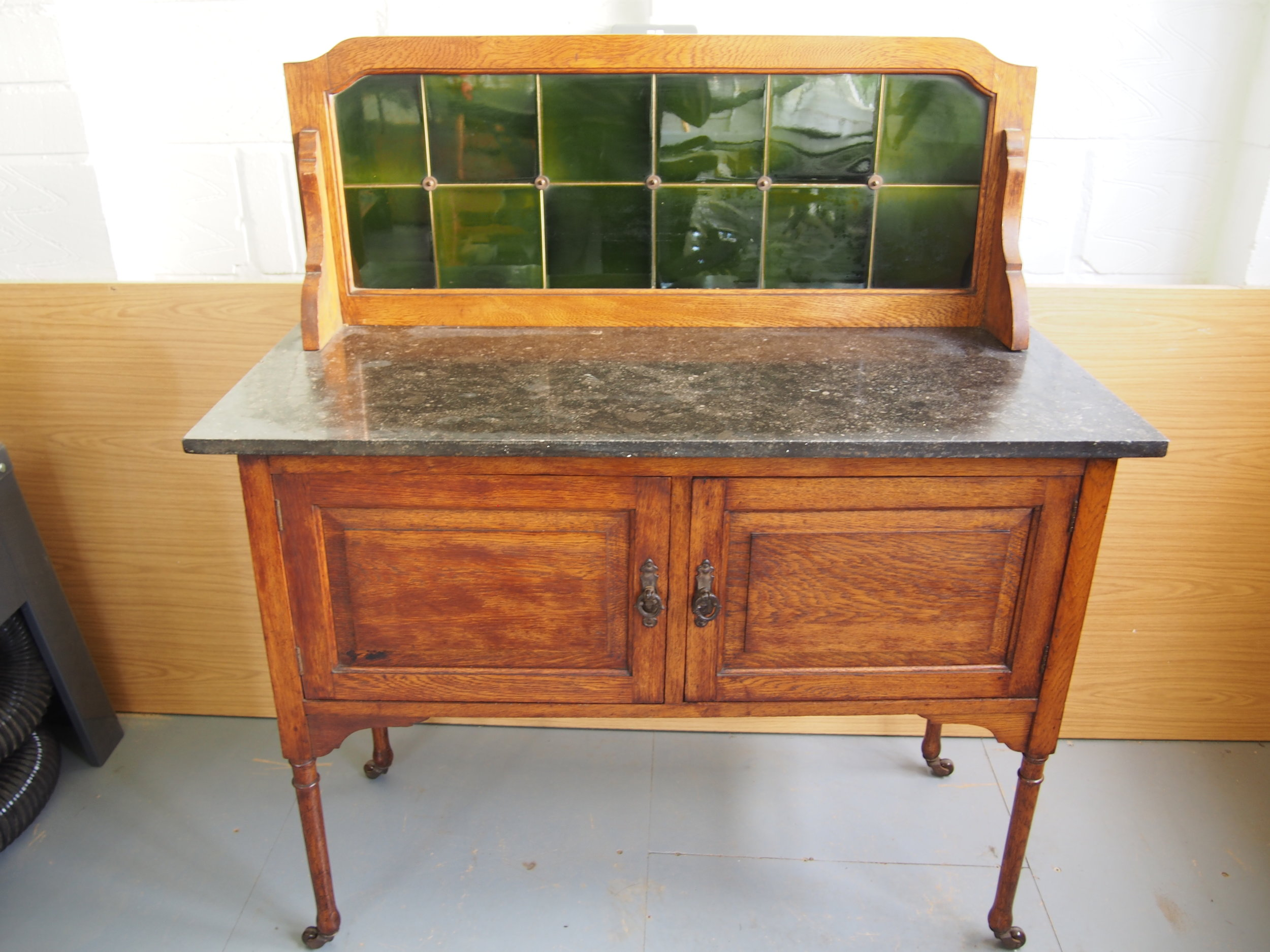 After Restoration of Oak Dressing Table   The old warn castors have been replaced. The piece has been thoroughly cleaned and re-polished.