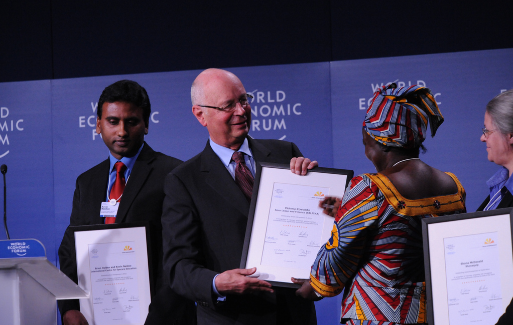Klaus Schwab, Founder and Executive Chairman, World Economic Forum and Victoria Kisyombe, Sero Lease and Finance Association (SELFINA) and Sero Businesswomen's Association (SEBA) at the World Economic Forum on Africa held in Dar es Salaam, Tanzania, May 5, 2010.