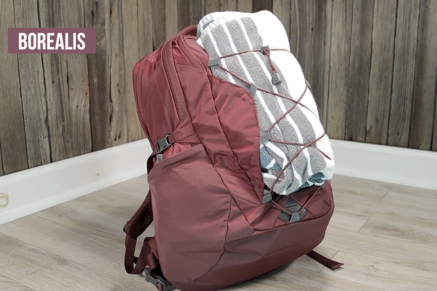 The North Face Borealis with beach towel attached to front