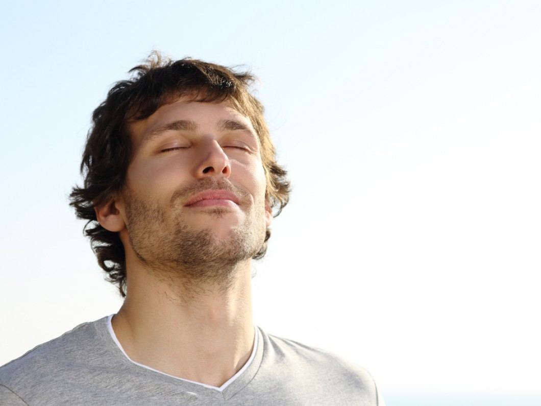 Attractive-Man-Breathing-Outdo-55213499.jpg