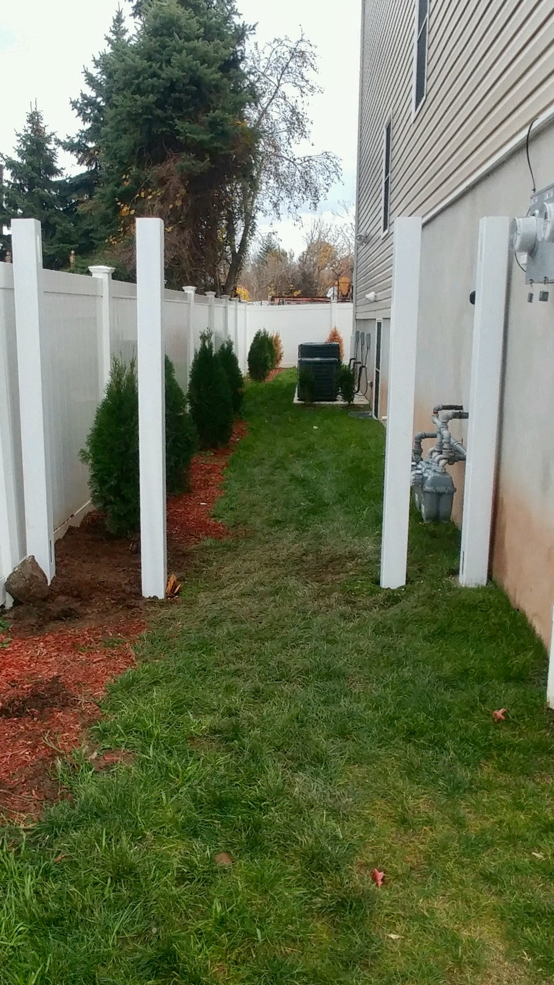 Vinyl Fence Posts being set for a vinyl fence gate installation