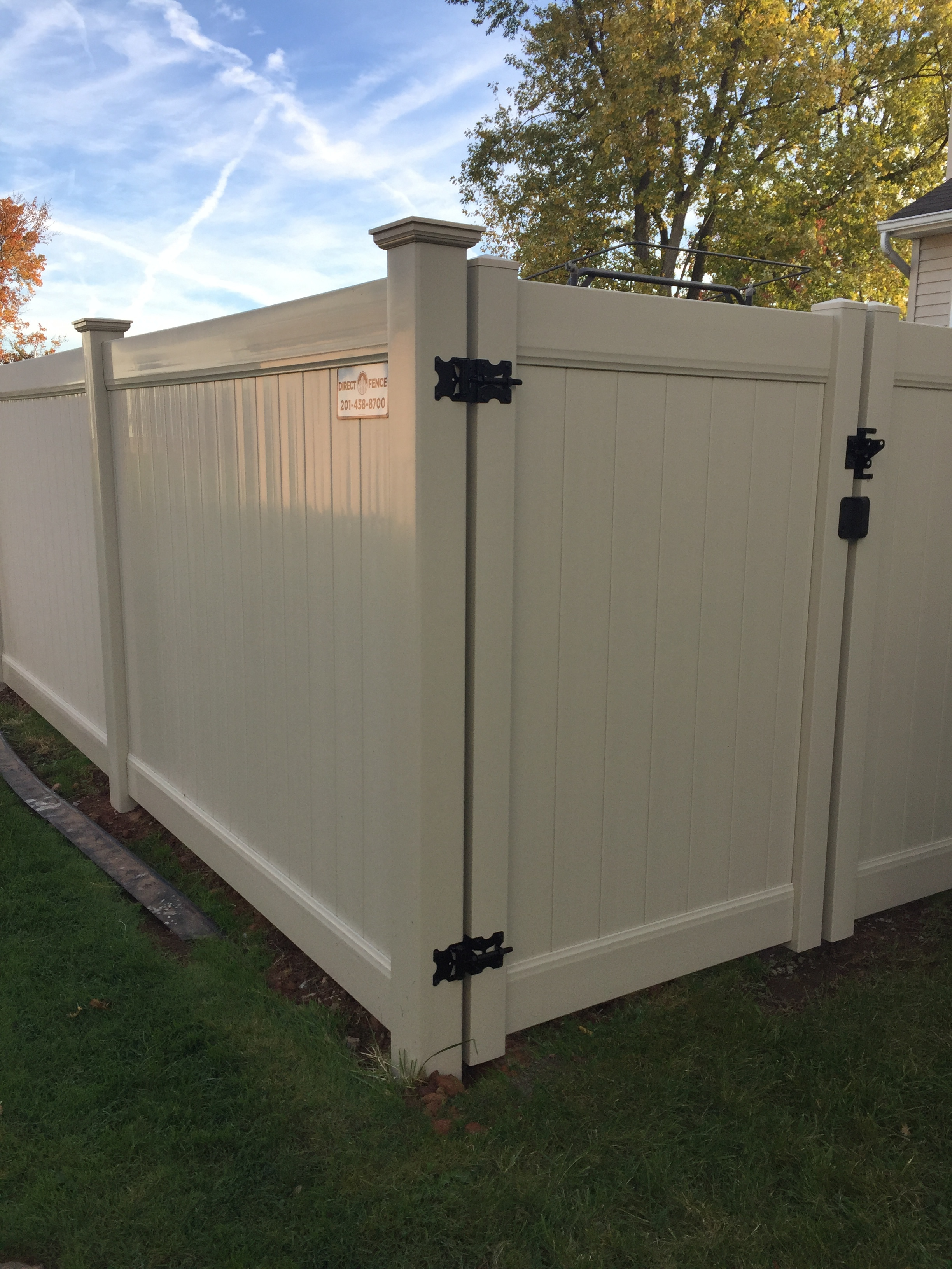 Beige Solid Privacy vinyl fence installation done by  Direct Fence
