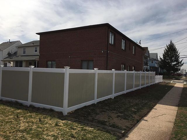 Two tone clay and white solid privacy vinyl fence installation finishing up in Colonia NJ #colonia #colonianj #vinylfence #fence #installation #house #home #backyard #nj #newjersey #spring