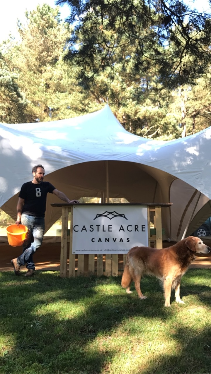 Alex from Castle Acre Canvas supplied the main Capree Tent which housed many of the Wedding Suppliers - Here he is just after he'd put it up.