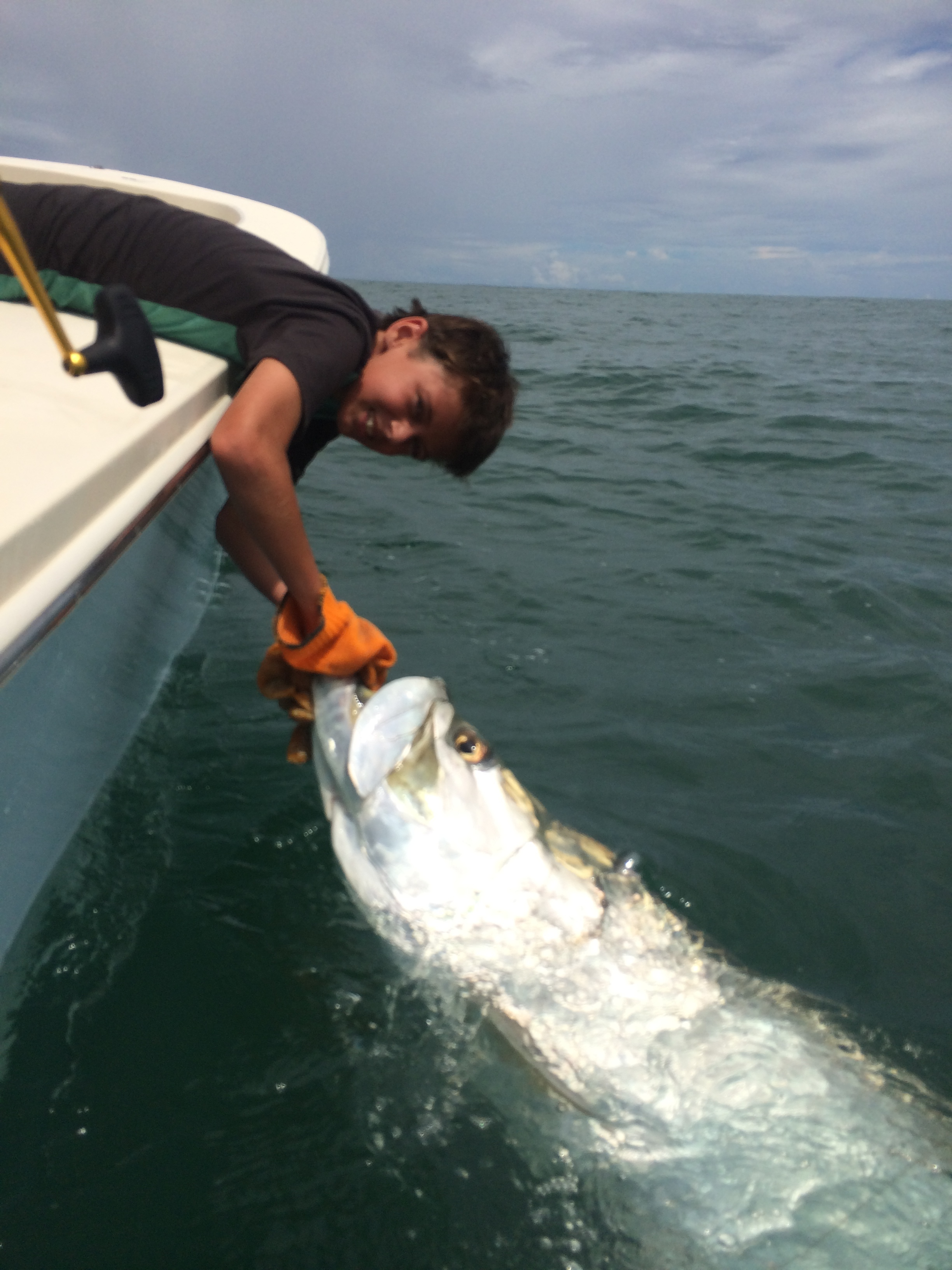 Reeling in Giant Tarpon on Fishing Charter