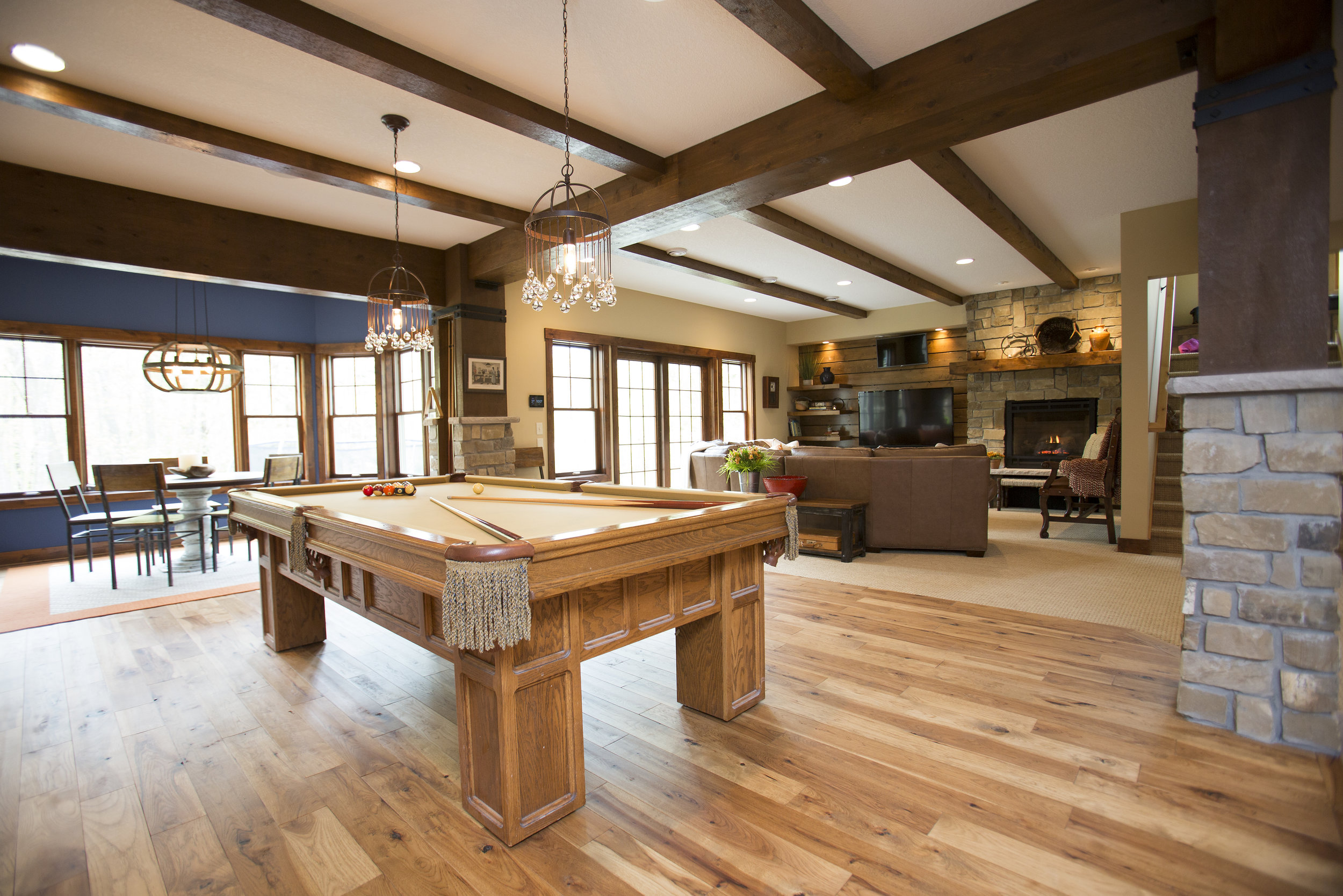 Wood remodeled pool table in an open style living room