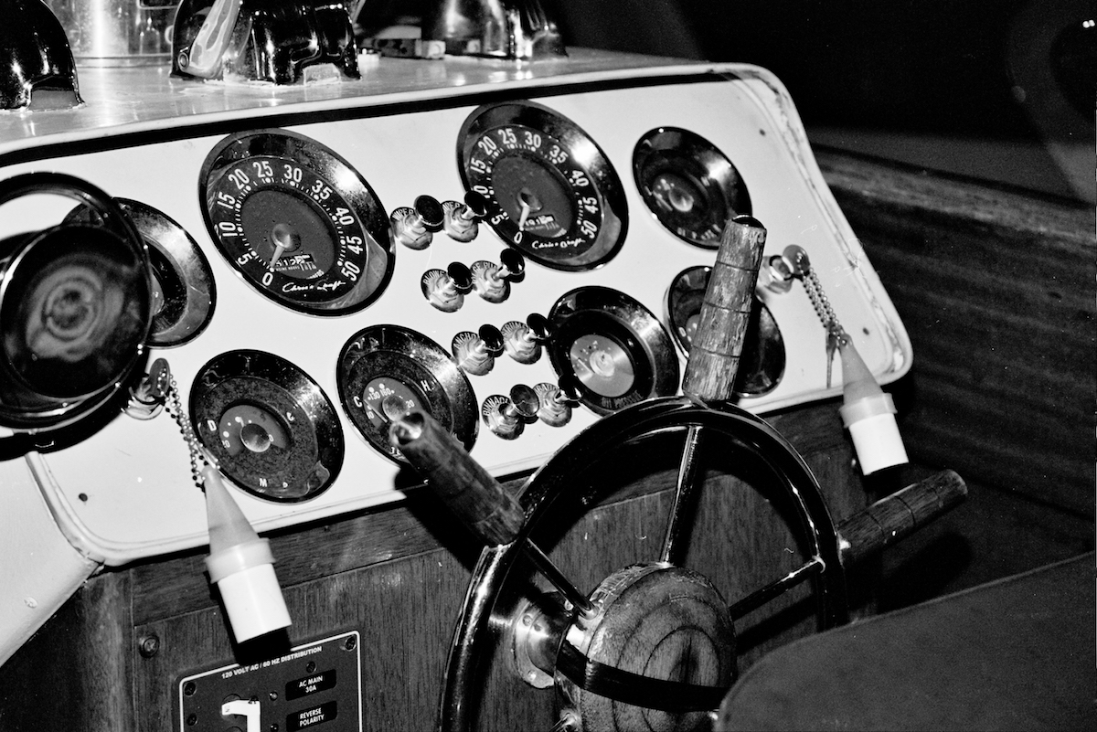 black and white photo inside of a captains boat