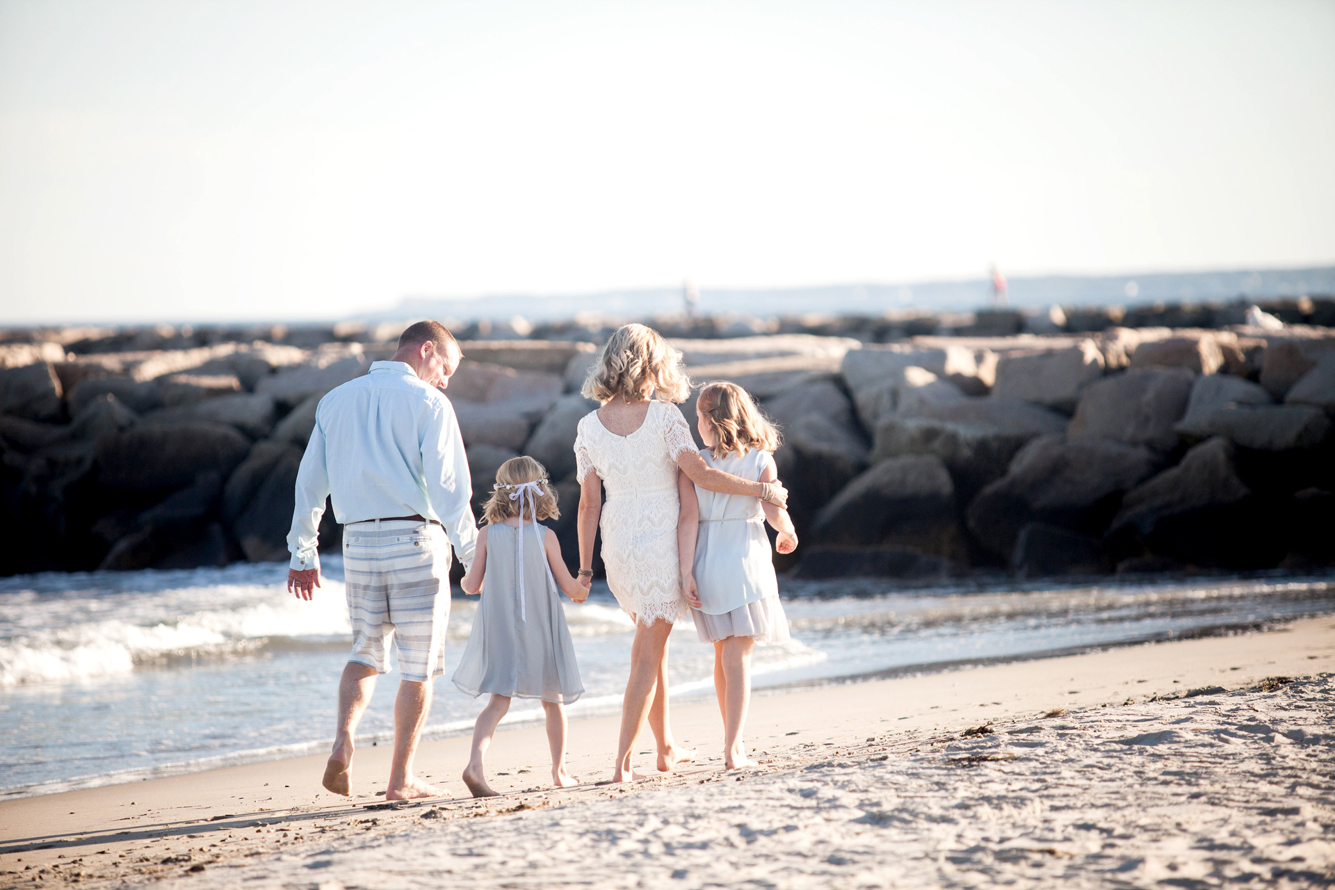 This is one of my favorite photographs of my family and I walking on the beach. It is natural, fun & timeless and will forever remind me of this special day in my family's life. Photography can be very powerful for this reason.