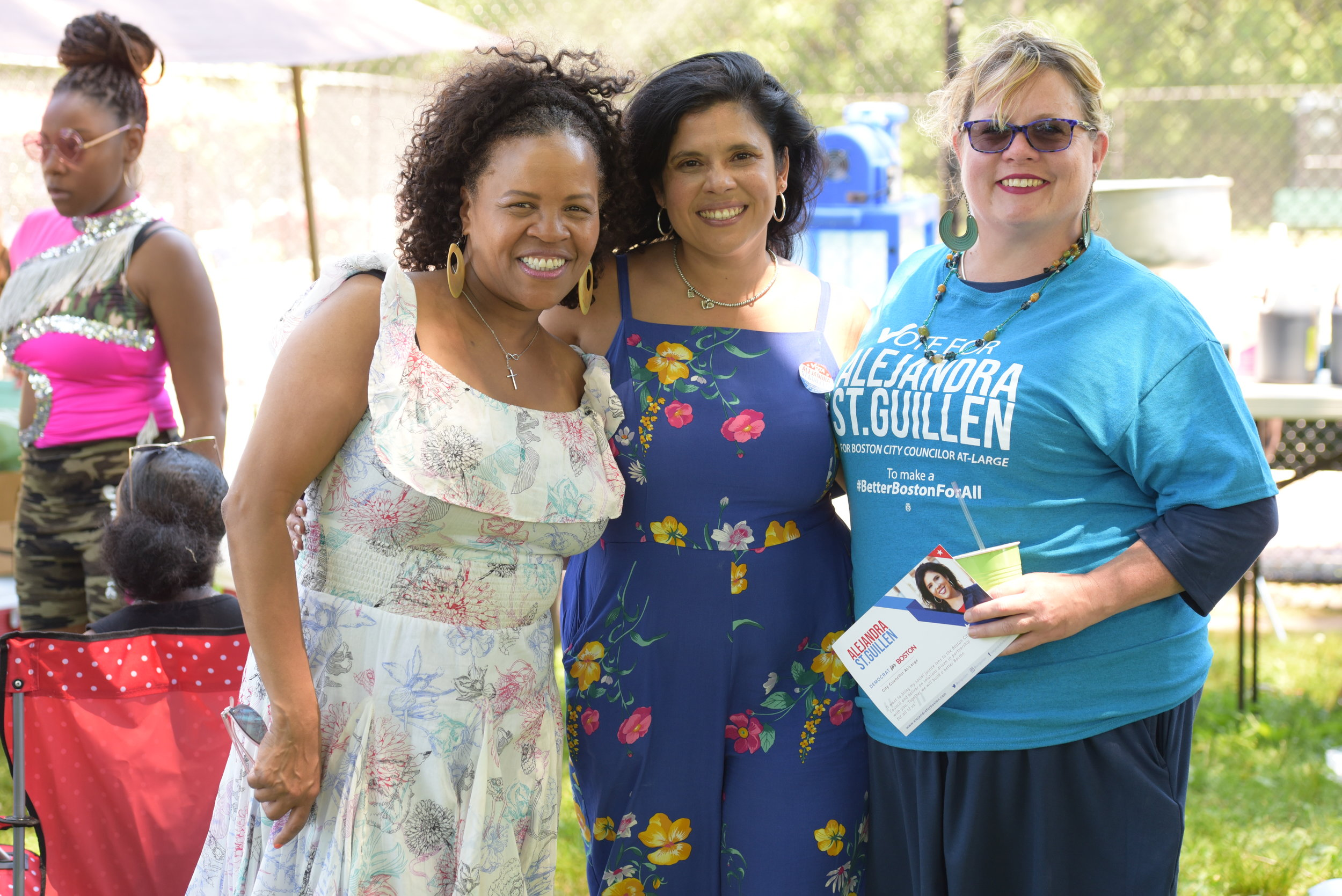 Boston City Councilor Kim Janey (District 7) and At Large Boston City Council Candidate Alejandra St. Guillen with local resident at Roxbury Annual Juneteenth Festival on June 15, 2019.