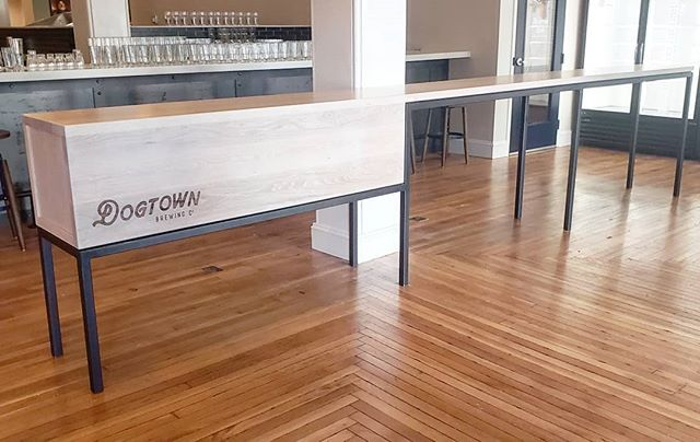 "Host/Hostess Stand for @dogtownbrewing.  Parson style 1/4"" floating reveal to match the brewery tables. 16'6"" x 18"" x 42""H joined with a half lap joint and delivered as 1 big piece.  Waterfall solid whiteoak front with rear sliding doors for storage. . . Laser logo by @kugolaser  Designed with @campfireandco  #wood #whiteoak #steel #woodworking #interiordesign #dowoodworking #rva #interiordesign #modern #brewery #handmade #makersmovement #rvamakers #restaurant #brewery #va #madeinamerica"