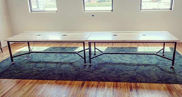 "15ft Ambrosia Maple ""Co-Work"" table, custom powder coated black base, in table Power/USB with walnut accent strip to help tie the two tables together as one. . For @gatherrva Designed with @campfireandco . . #woodwork #ambrosiamaple #walnut #table #modern #interiordesign #power #rva #makersmovement #madeinamerica #handmade #handcrafted #office #va #metalworking  #steel #welding #maple"