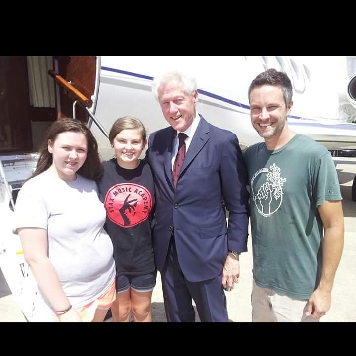 Adam, Savannah, and Savannah's best friend, Svea taking food onto former President Bill Clinton's private jet.