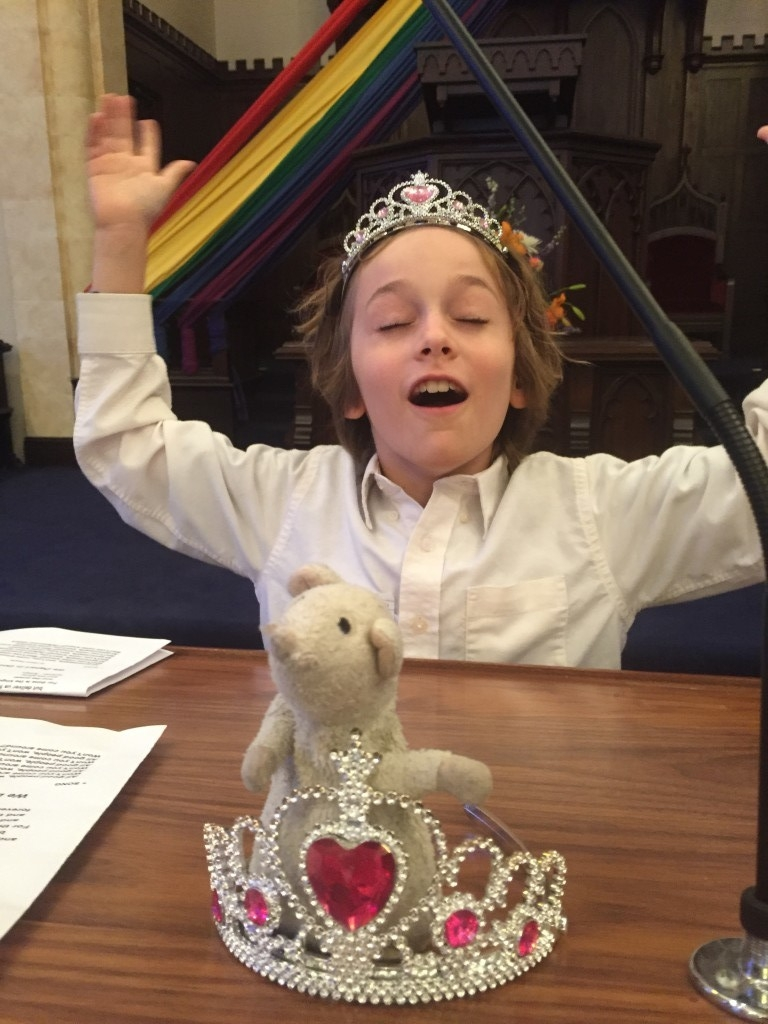 "Young Pilgrim celebrates Tiara Sunday by placing a tiara around his favorite ""lovie""."