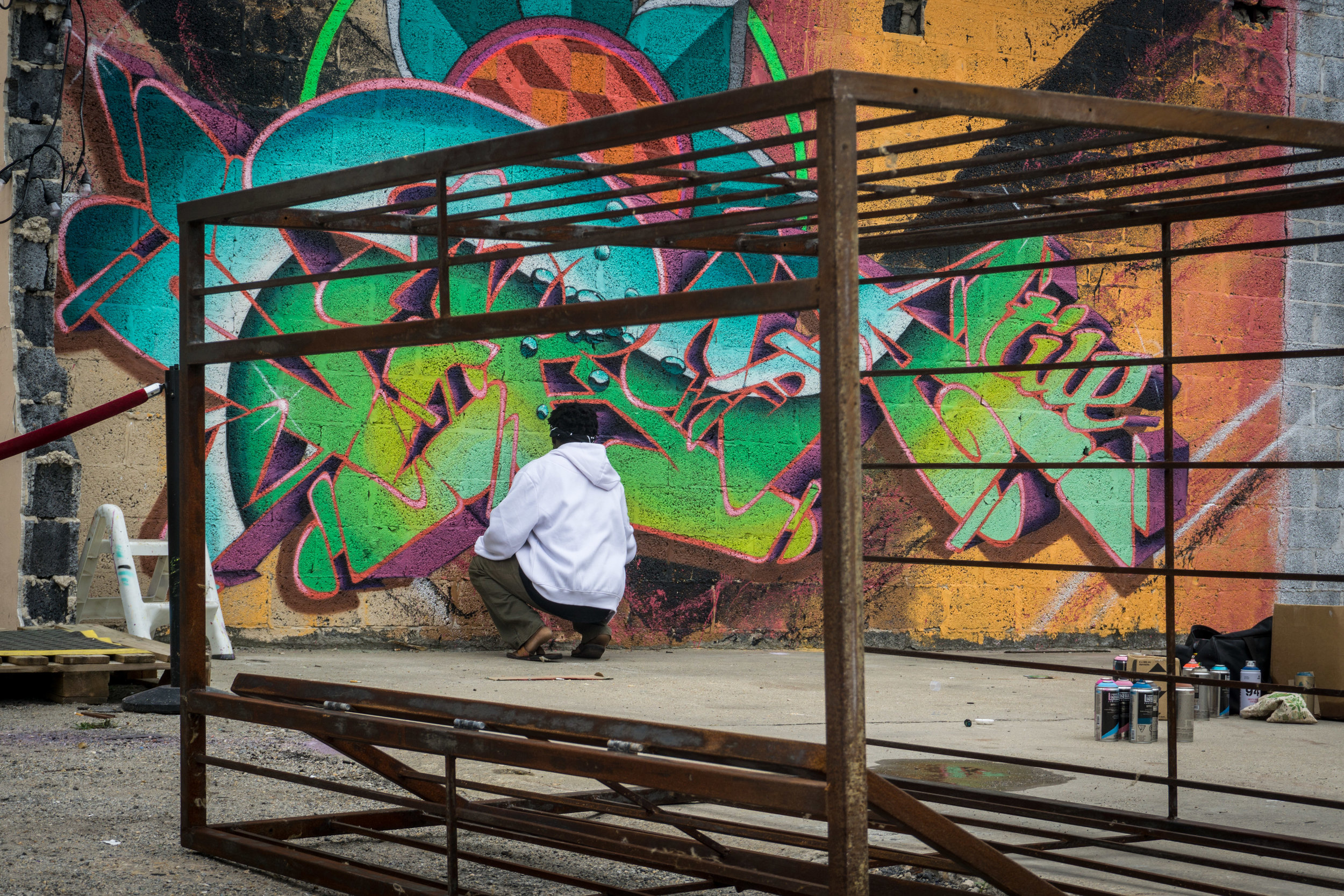Graffiti artist, Versatile Vice (Vice Versa), brings life to a wall in the 3!5 courtyard.