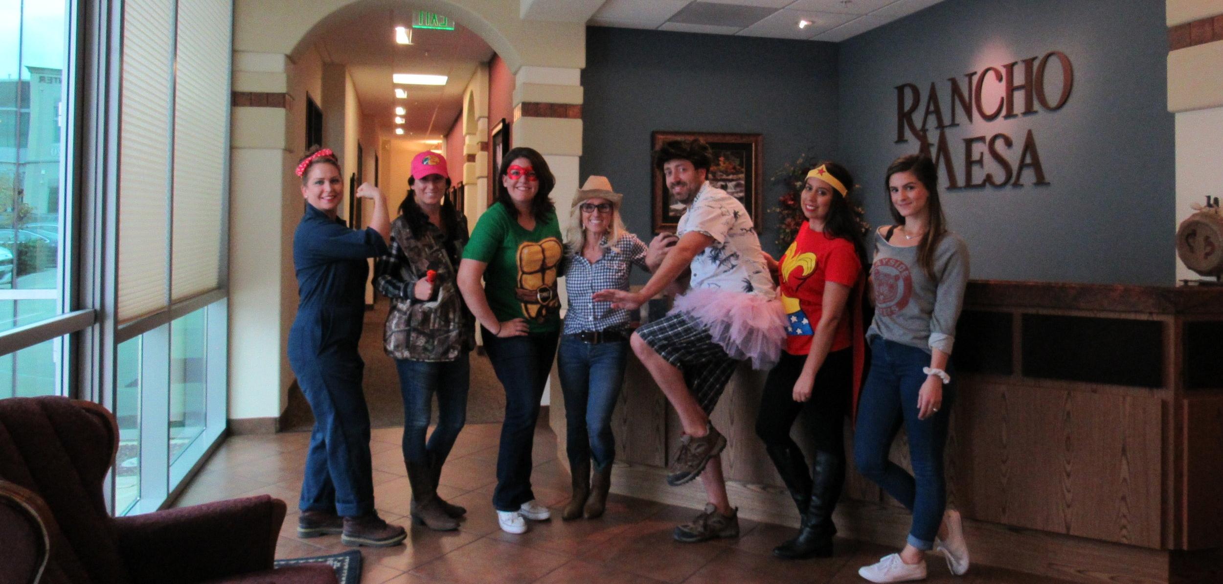 Left to right: Rosie the Riveter (Alyssa Burley), Hunter (Jessica Morton), Teenage Mutant Ninja Turtle (Christina Haake), Cowgirl (Lori Stone), Ace Ventura (John Parker), Wonder Woman (Brittani Kyriss), and Kelly Kapowski (Sierra Pedersen)