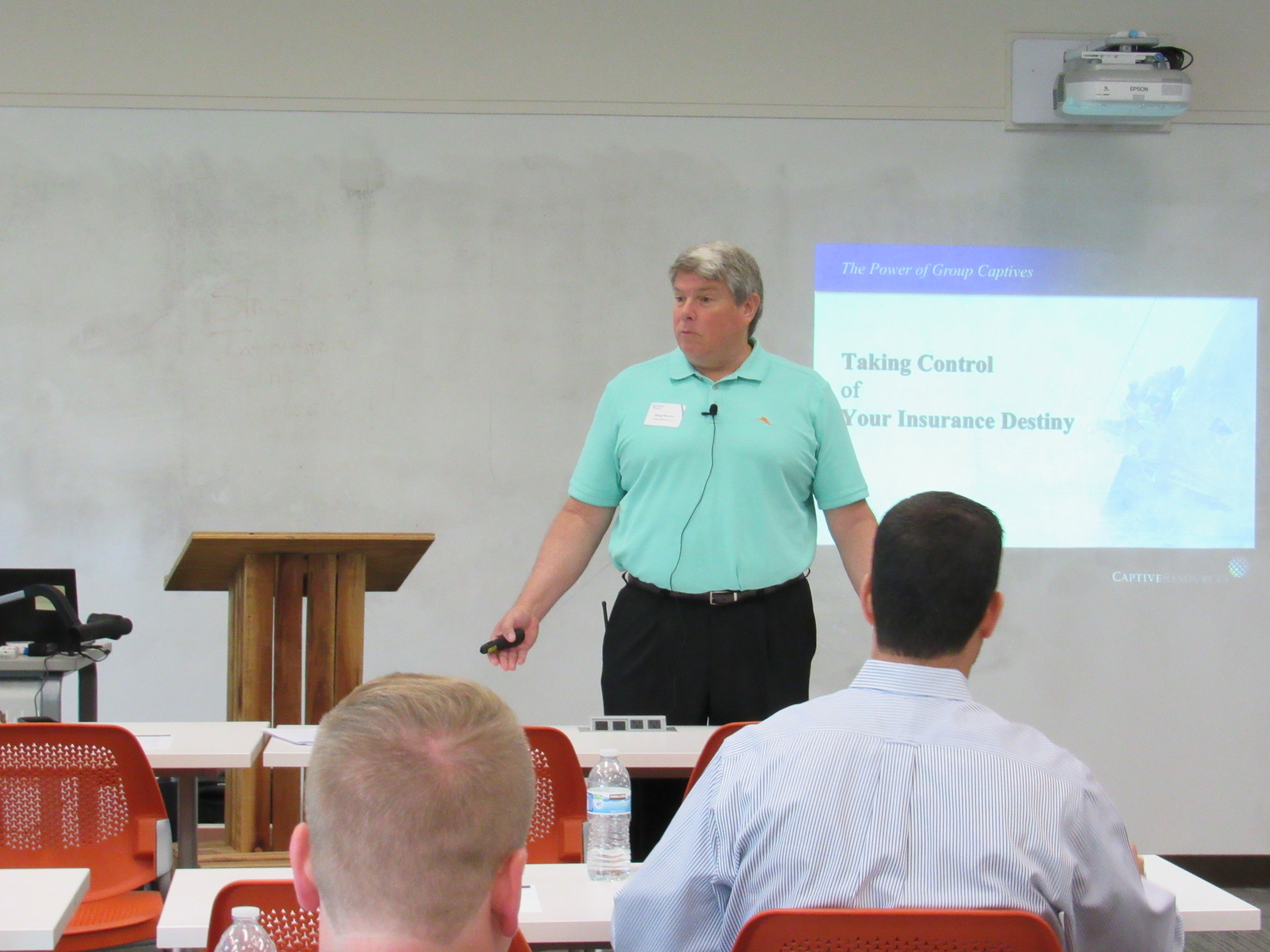 Doug Hayden speaking in front of a group of people.