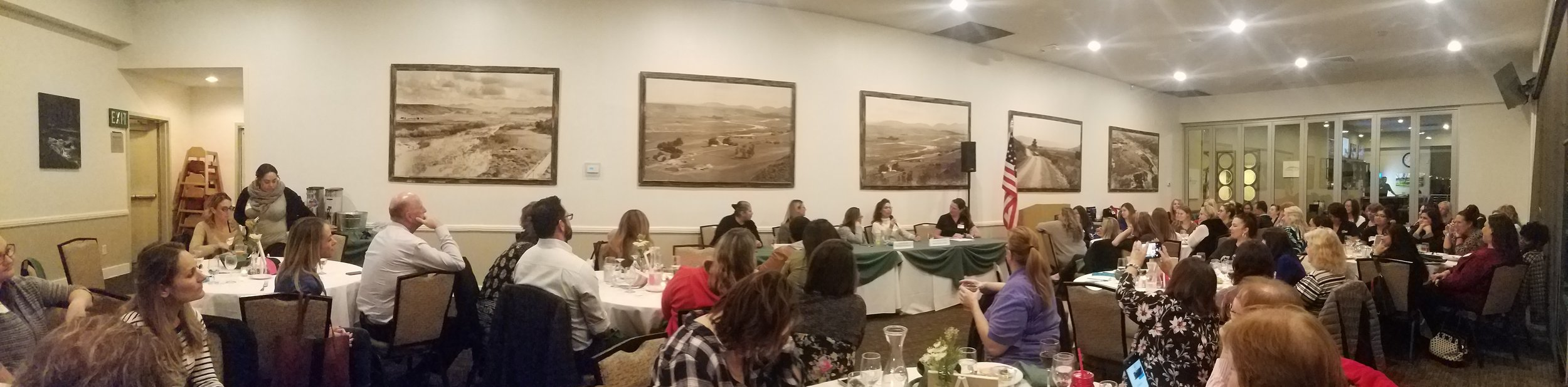 Large banquet room full of women and a few men at tables.