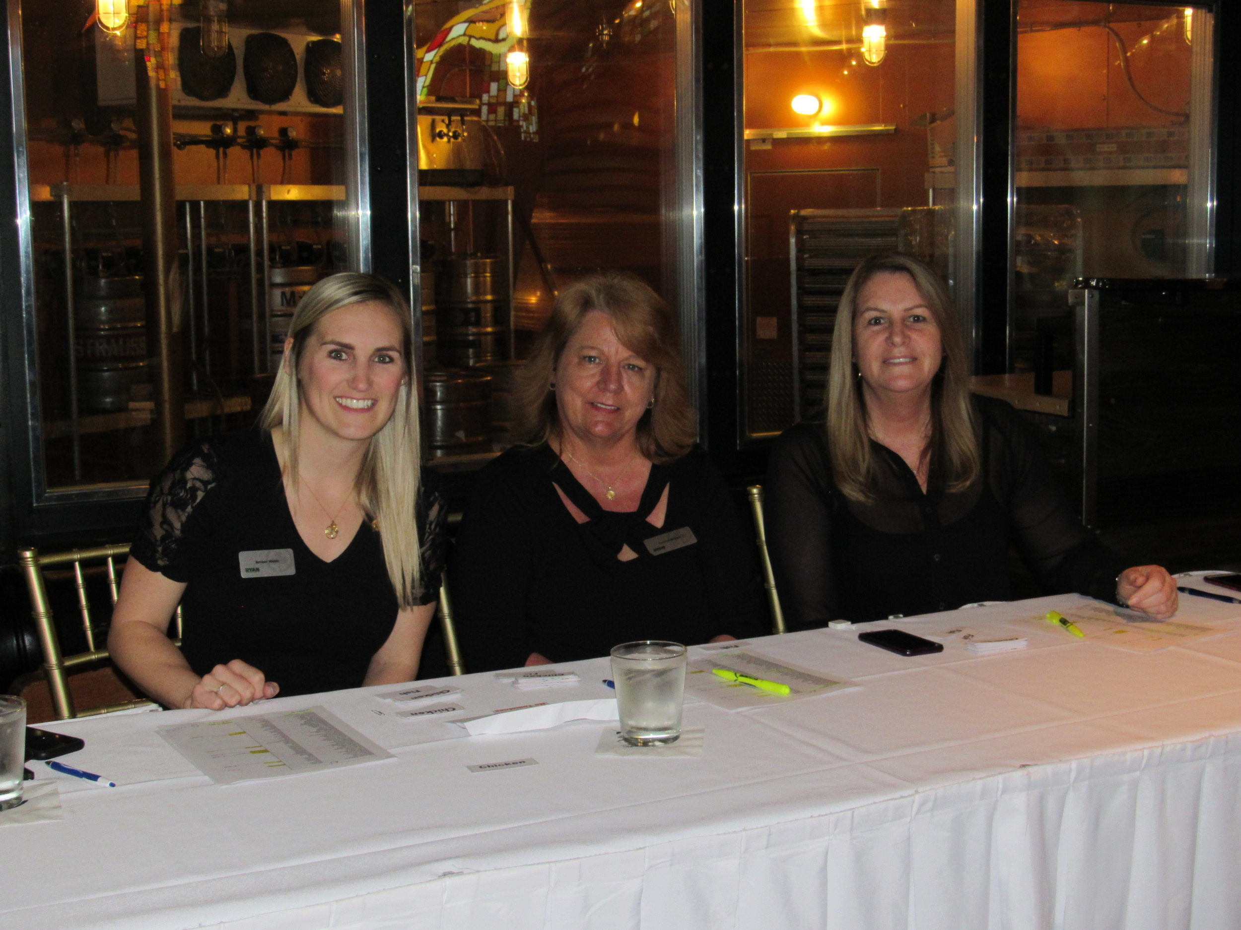 Amber Webb and two ladies sitting at registration table